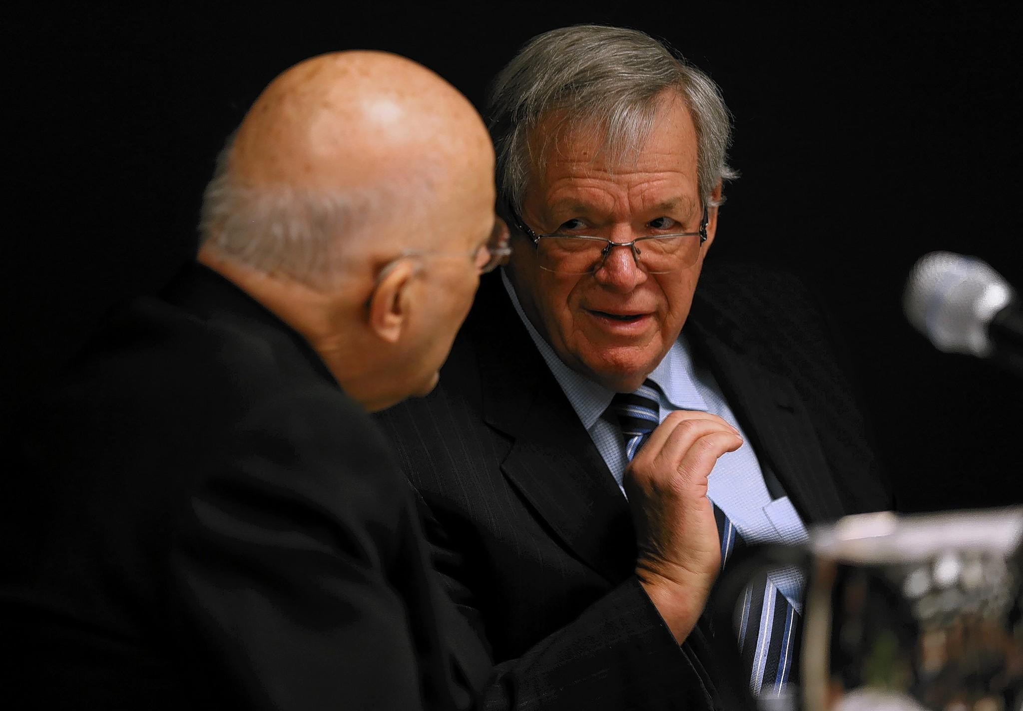 Cardinal Francis George, left, and former U.S. House Speaker Dennis Hastert said in an appearance at DePaul University on Tuesday that Congress should pass immigration reform.