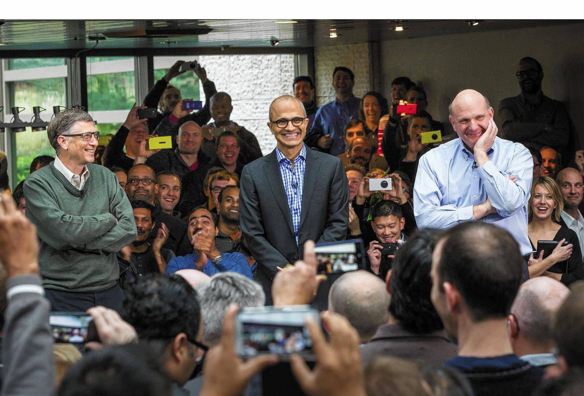 Satya Nadella, Microsoft's new CEO, addresses employees along with Bill Gates and Steve Ballmer at the company's Redmond, Wash., campus.