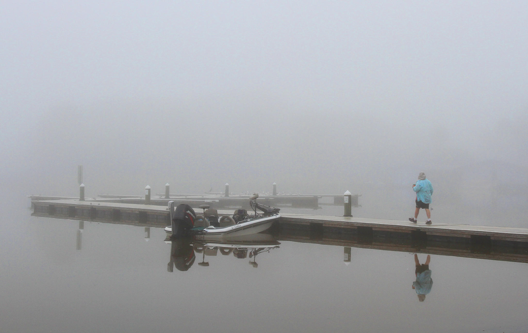 A fisherman prepares to motor into the fog on Lake Dora in Mount Dora on Tuesday, February 4, 2014.