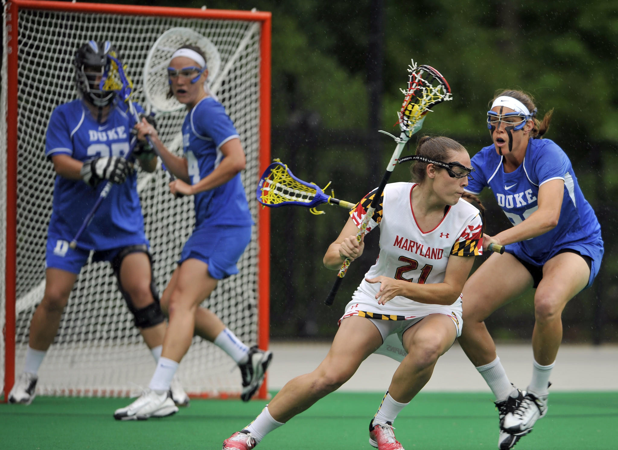 College Park, Md--5/18/13--Left to right, #21 Taylor Cummings, Maryland, moves the ball closely watched by #23 Amalie Trentzsch, Duke. Duke at Maryland women's lacrosse NCAA tournament quarterfinal. Kim Hairston/Baltimore Sun Staff. #2485.