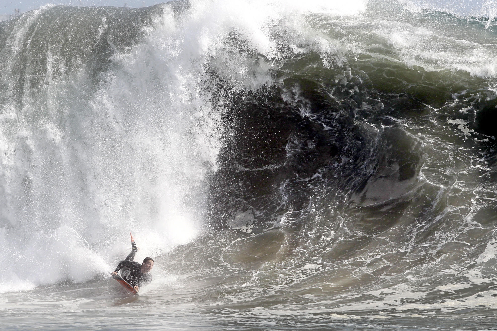A bodyboarder catches a wave at The Wedge in Newport Beach in March.