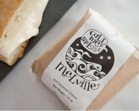 Mystic Cheese's flagship curd is Melville, pictured here in its packaging and inside a grilled cheese sandwich.