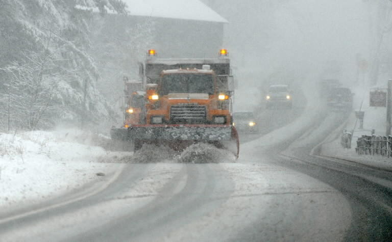 A file photo of trucks plowing Route 10 in Simsbury.