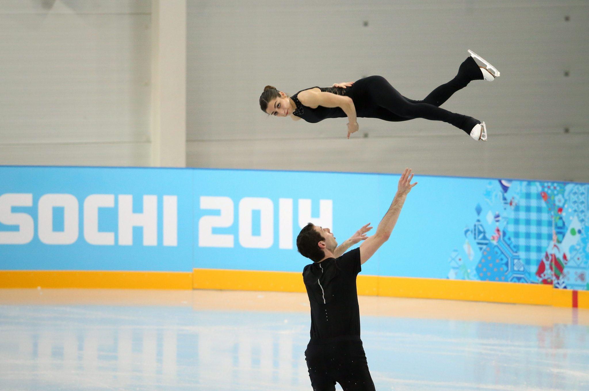 Simon Shnapir launches Marissa Castelli into a throw twist at practice.
