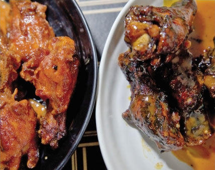 "The nationally recognized ""Dirt"" wings at J. Timothy's in Plainville are fried, dipped in sauce, then fried and sauced again."