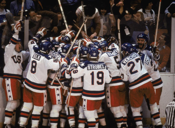 Team USA celebrates its 4-3 victory over the Soviet Union in the semi-final at the 1980 Winter Olympics in Lake Placid.  (Steve Powell / Getty Images)