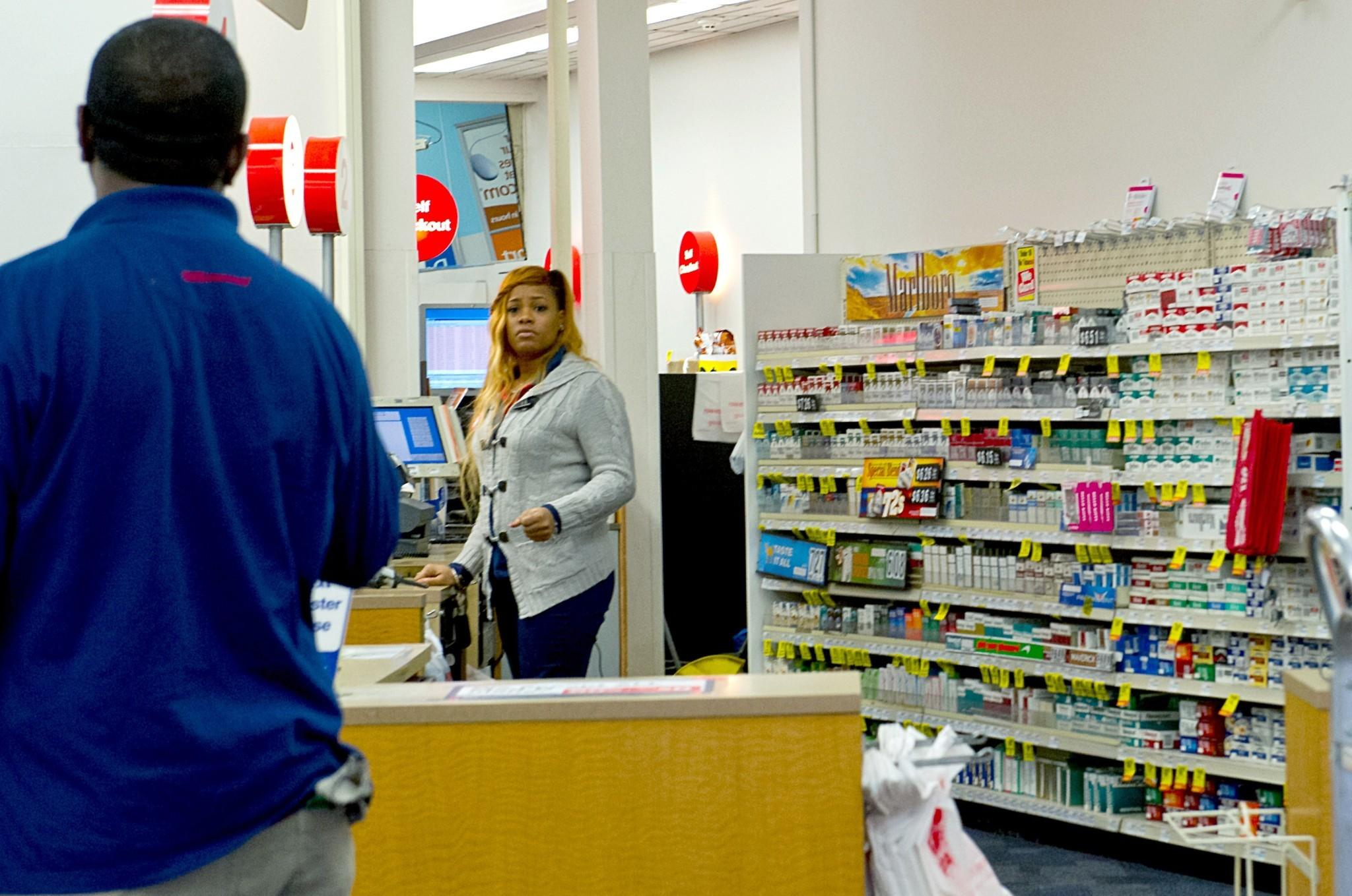 cvs stubs out tobacco s a step other companies should take a clerk mans the cigarette counter at a cvs drugstore in washington