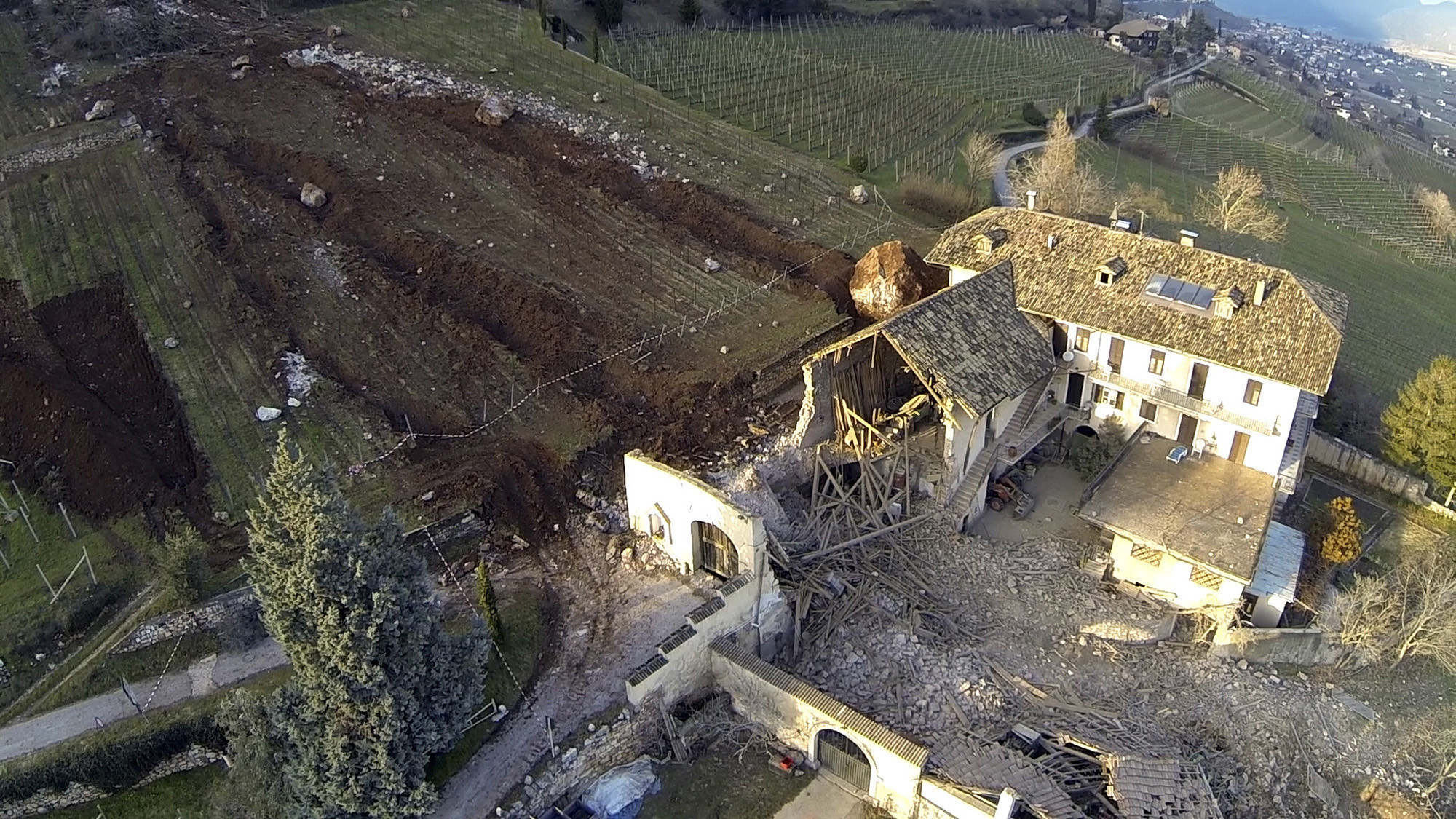 Huge boulder tumbles past farmhouse, destroys barn in Italy - Huge boulder