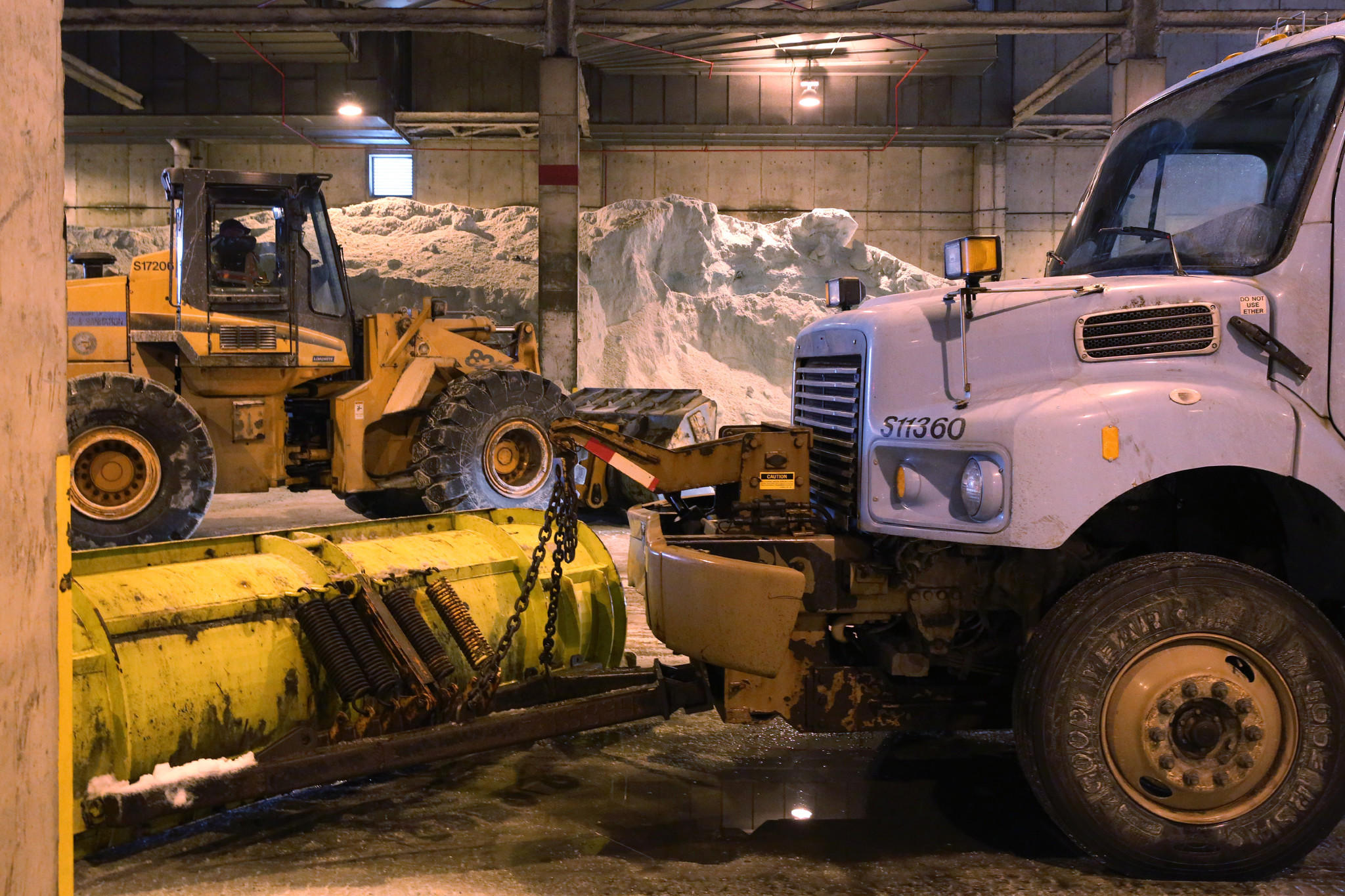 A snow plow sits at the ready prior to a press event with Mayor Rahm Emanuel Saturday, Feb. 1, 2014 at the McCormick Place indoor salt pile in Chicago.