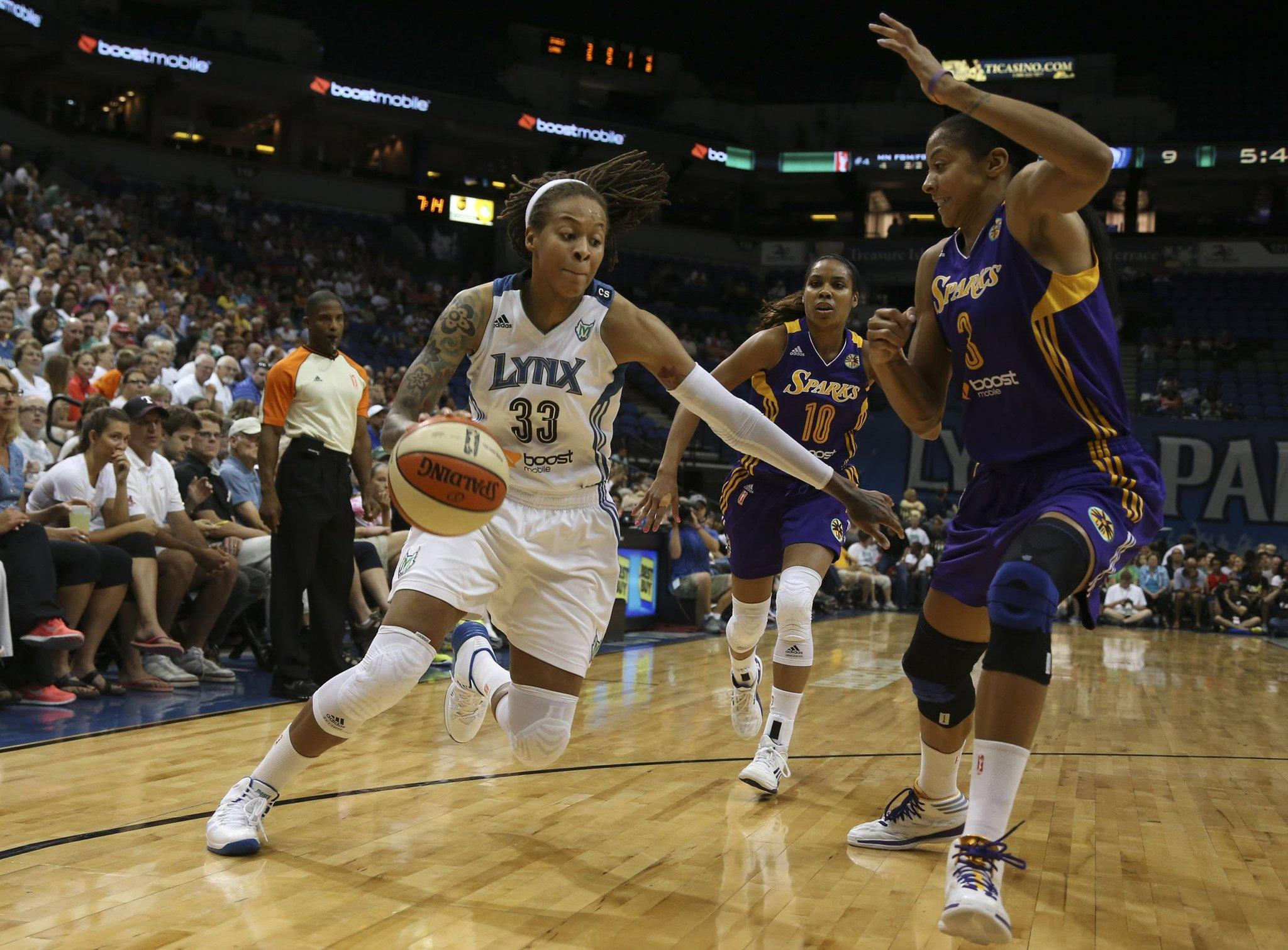 Seimone Augustus (33) of the Minnesota Lynx drives against the Los Angeles Sparks' Candace Parker in the first half at the Target Center in Minneapolis.