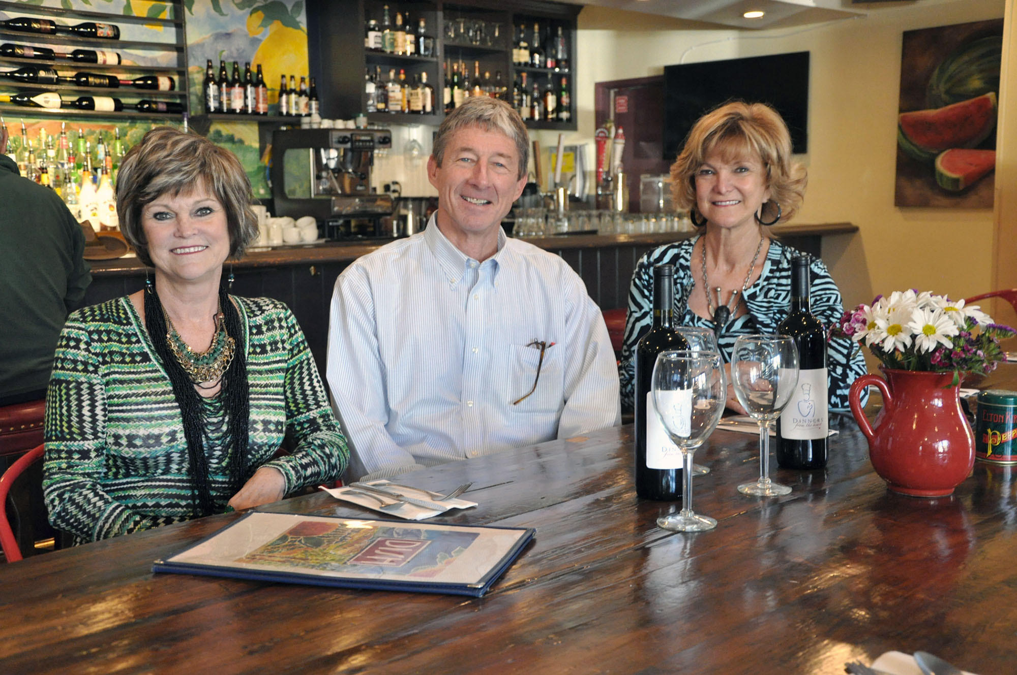 Karen Sellergren, from left, Dish owner Kevin Finch and Sandi Mellin make plans for the upcoming Dinners from the Heart event, an annual fundraiser for Hathaway-Sycamores.