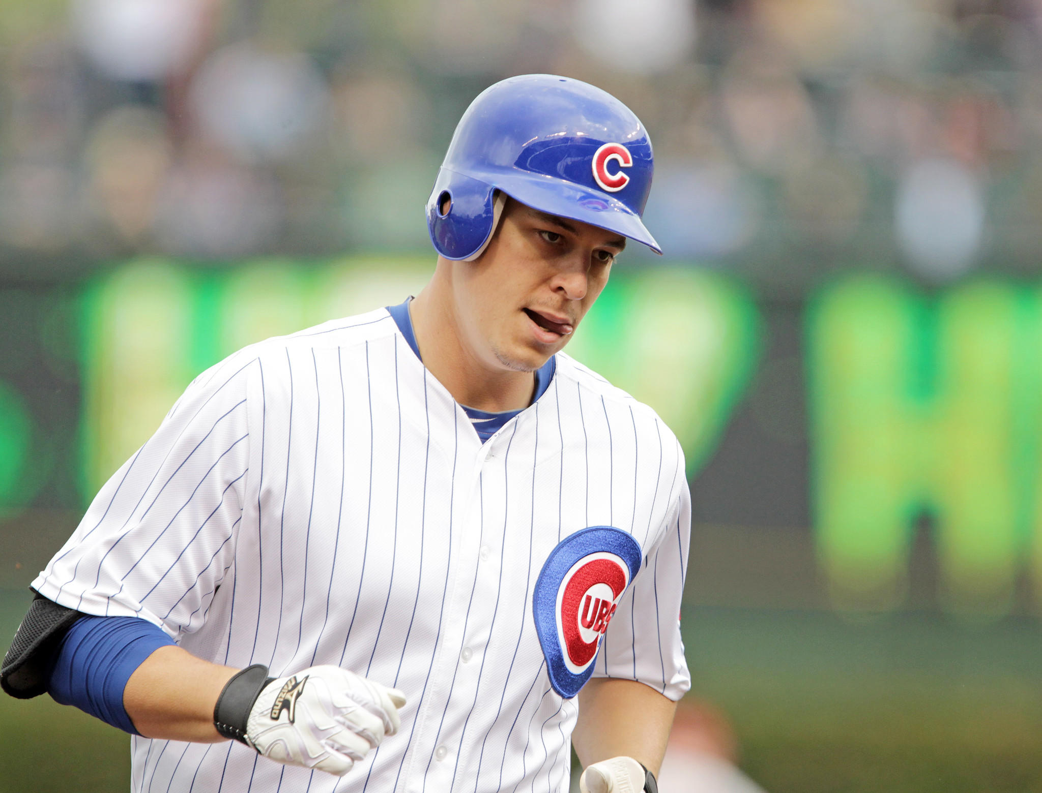Bryan LaHair of the Cubs rounds the bases after hitting a home run on Oct. 3, 2012.