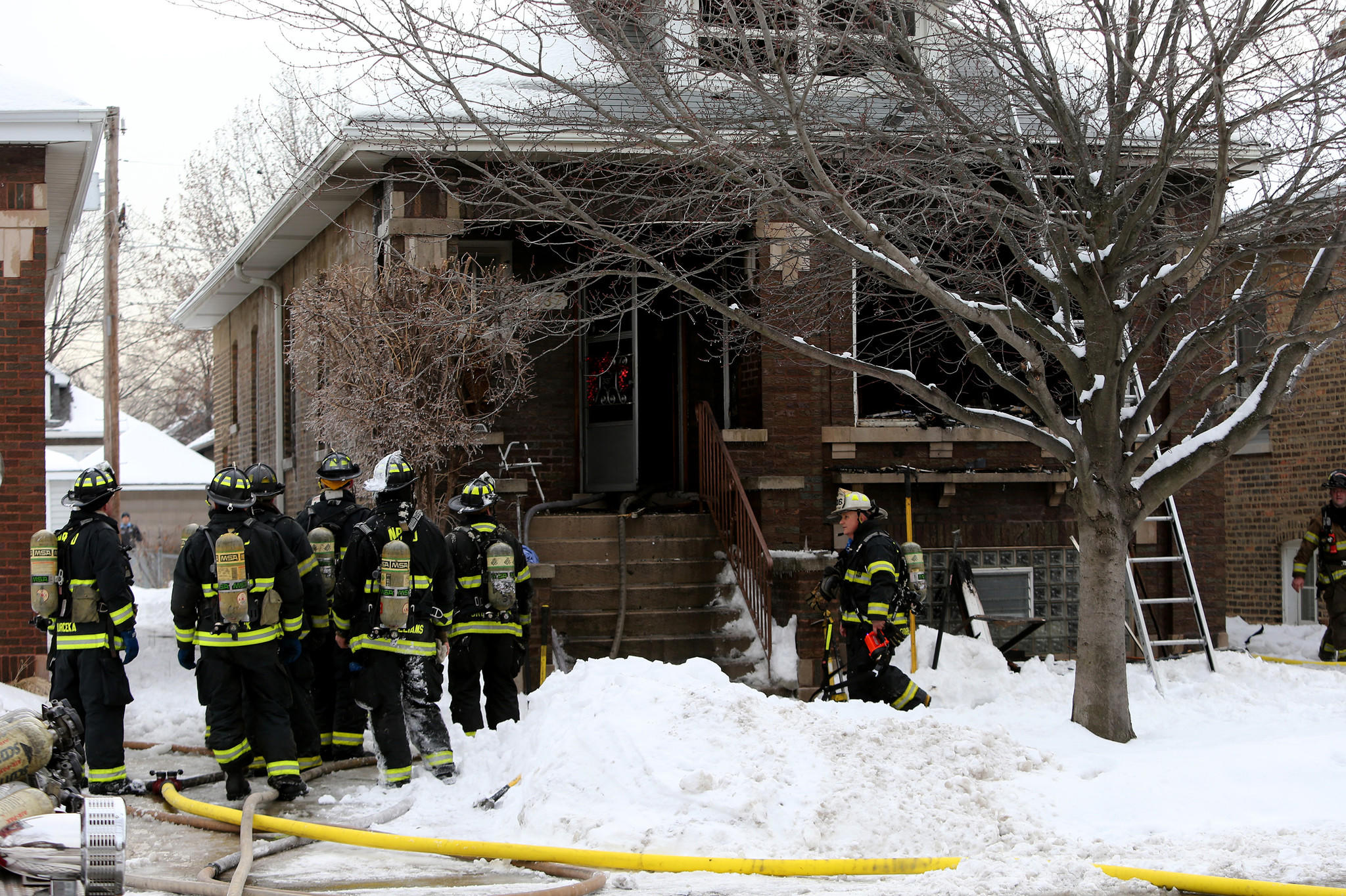 Berwyn firefighters clean up following a fire in the 2400 block of South Scoville Avenue in Berwyn on Tuesday.