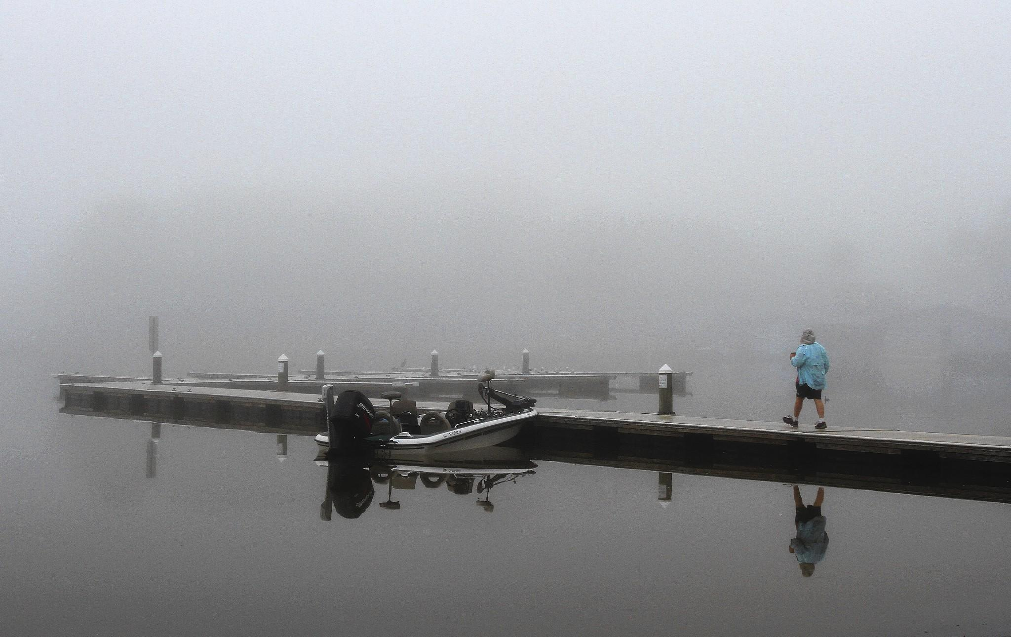 A fisherman prepares to motor into the fog on Lake Dora in Mount Dora, Fl. on Tuesday, February 4, 2014.