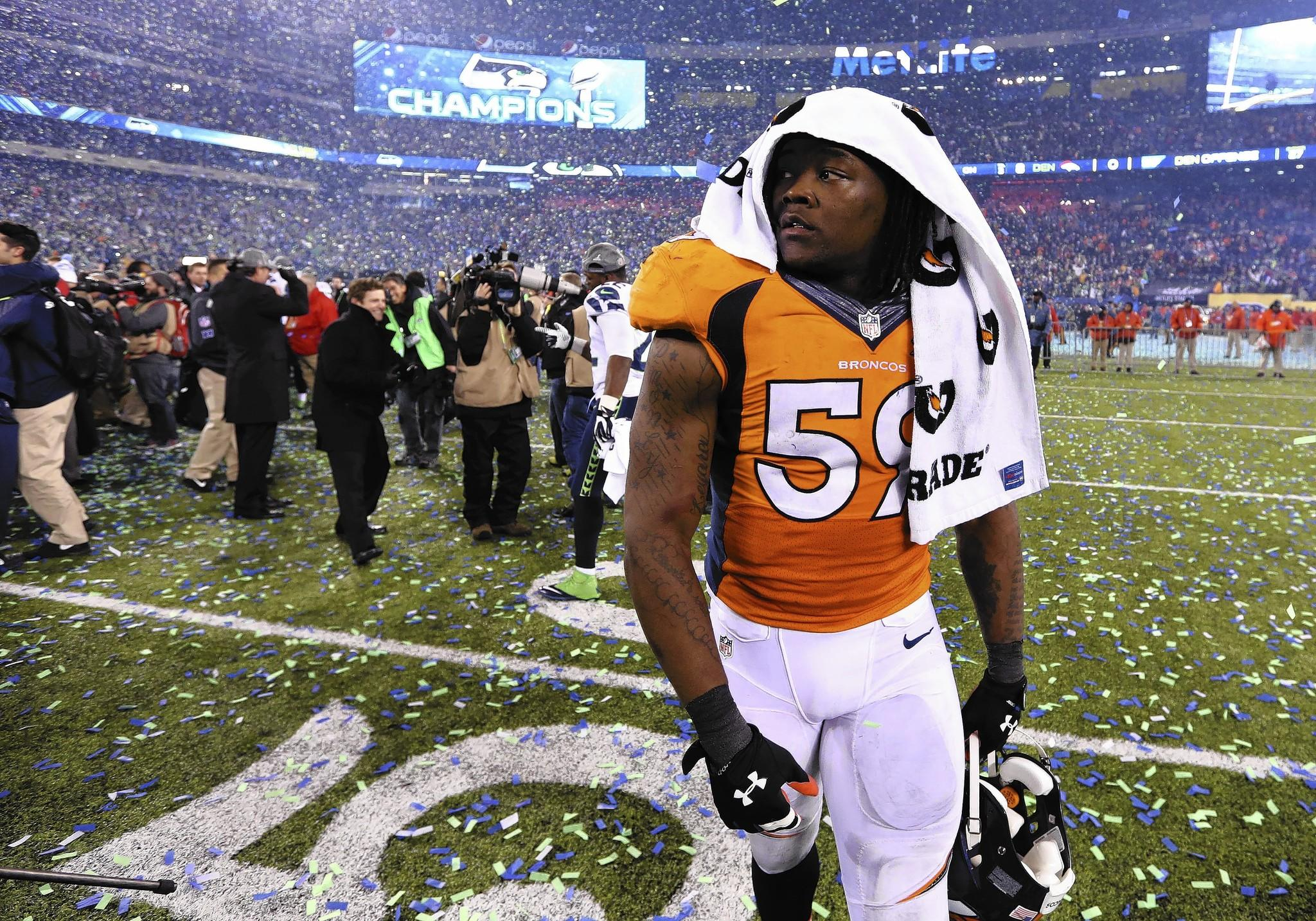 Denver Broncos linebacker Danny Trevathan walks off the field after losing the Super Bowl against the Seattle Seahawks at MetLife Stadium. Seattle Seahawks won 43-8.