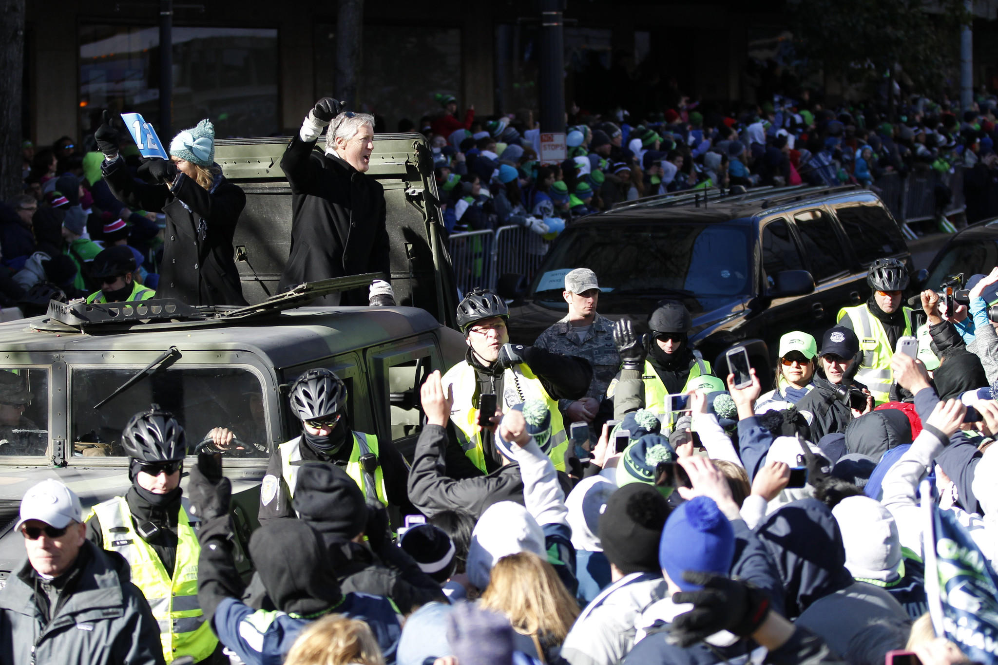 Seattle Seahawks head coach Pete Carroll waves to the crowd during a Super Bowl championship parade held in downtown Seattle.=