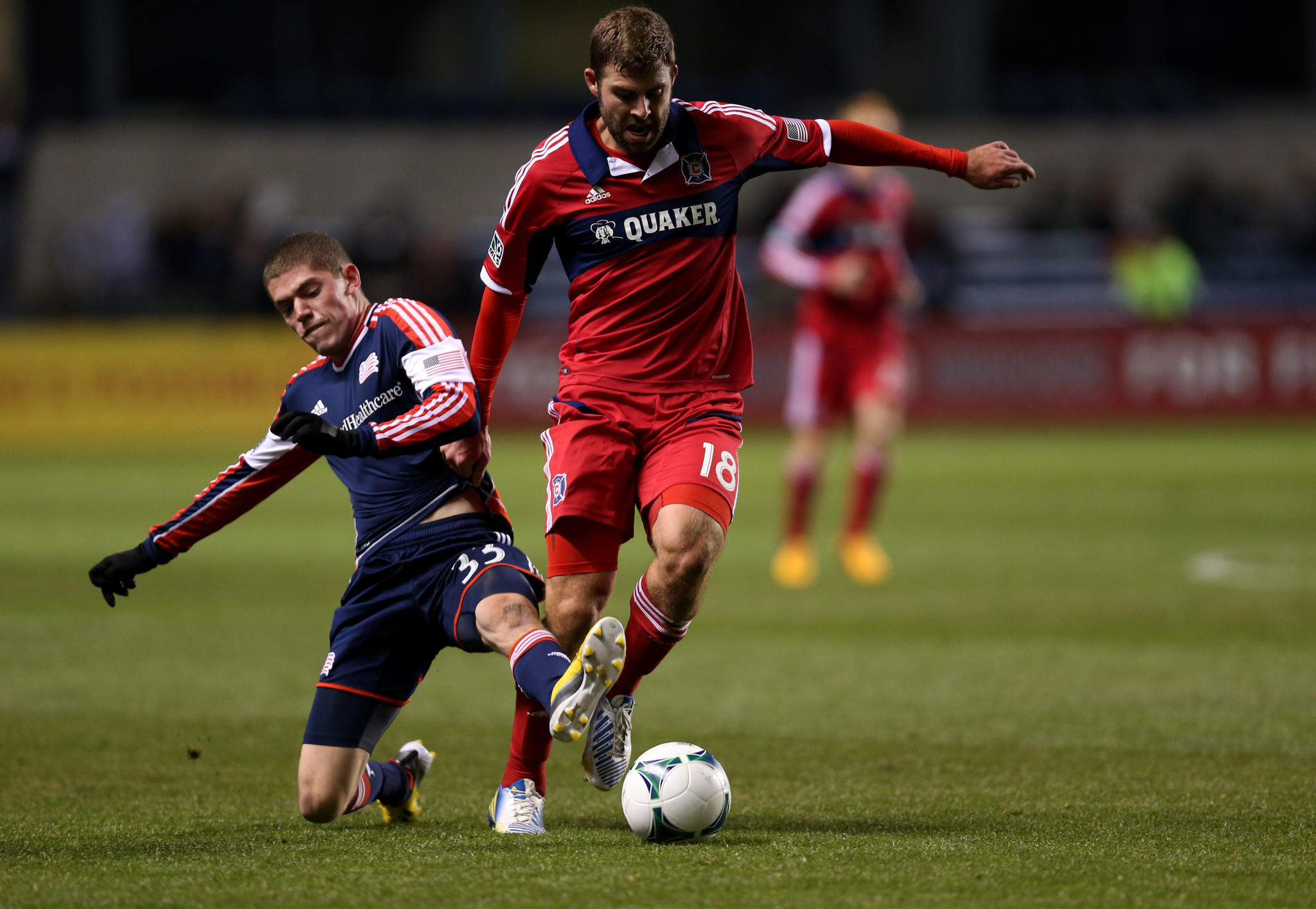 Steven Kinney and Revolution midfielder Donald Smith battle for the ball in the first half at Toyota Park in Bridgeview.