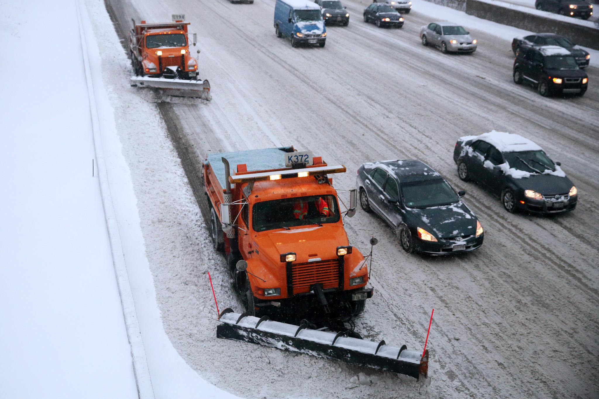 IDOT snow plows work to clear the snow covered roads and cover them with salt after an overnight snow storm covered the city Wednesday, Feb. 5, 2014 on the Kennedy Expressway in Chicago.