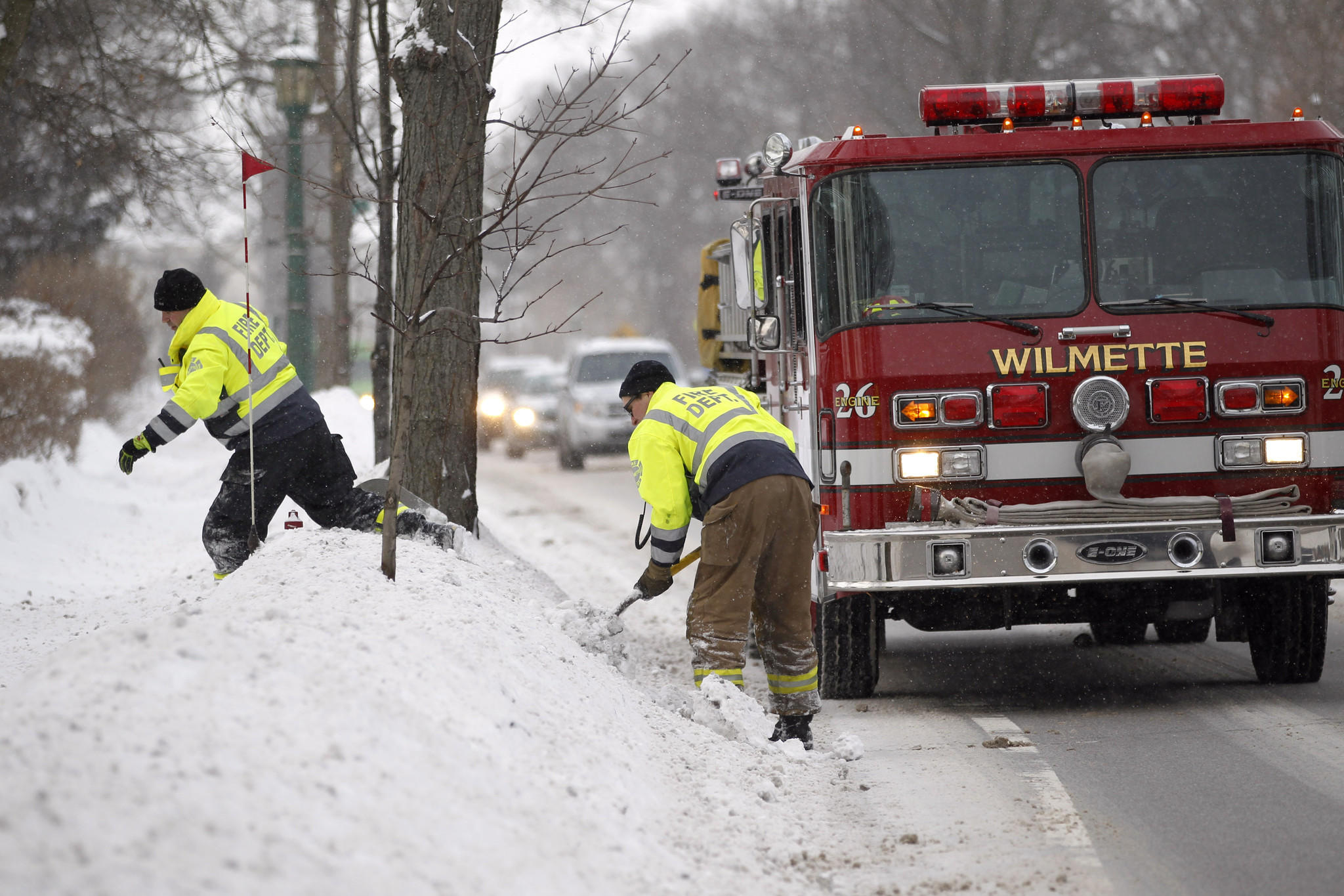 Wilmette firefighters shovel snow to clear fire hydrants Feb. 5 along Sheridan Road north of Isabella Street in Wilmette.