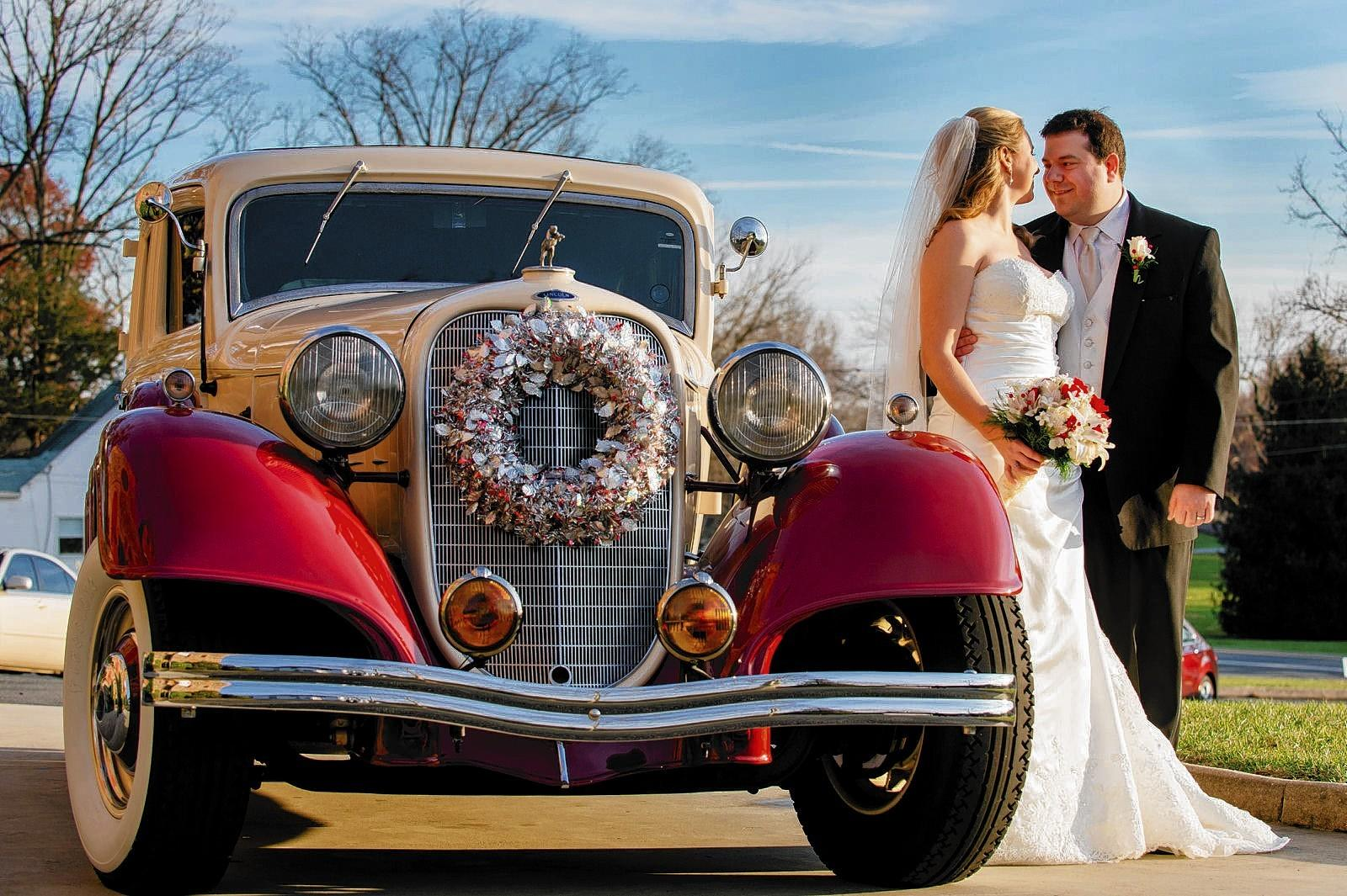 Michelle Zilka and Joshua Mawhinney left their wedding in a 1934 classic Lincoln.