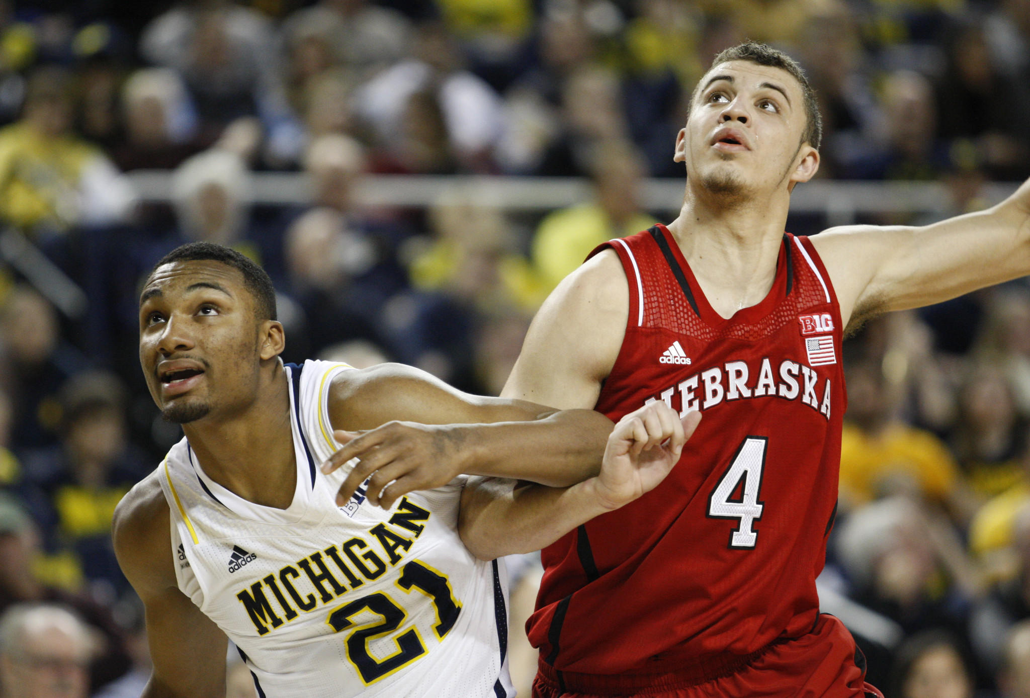 Michigan's Zak Irvin and Nebraska's Nathan Hawkins fight for position during the second half at Crisler Arena.