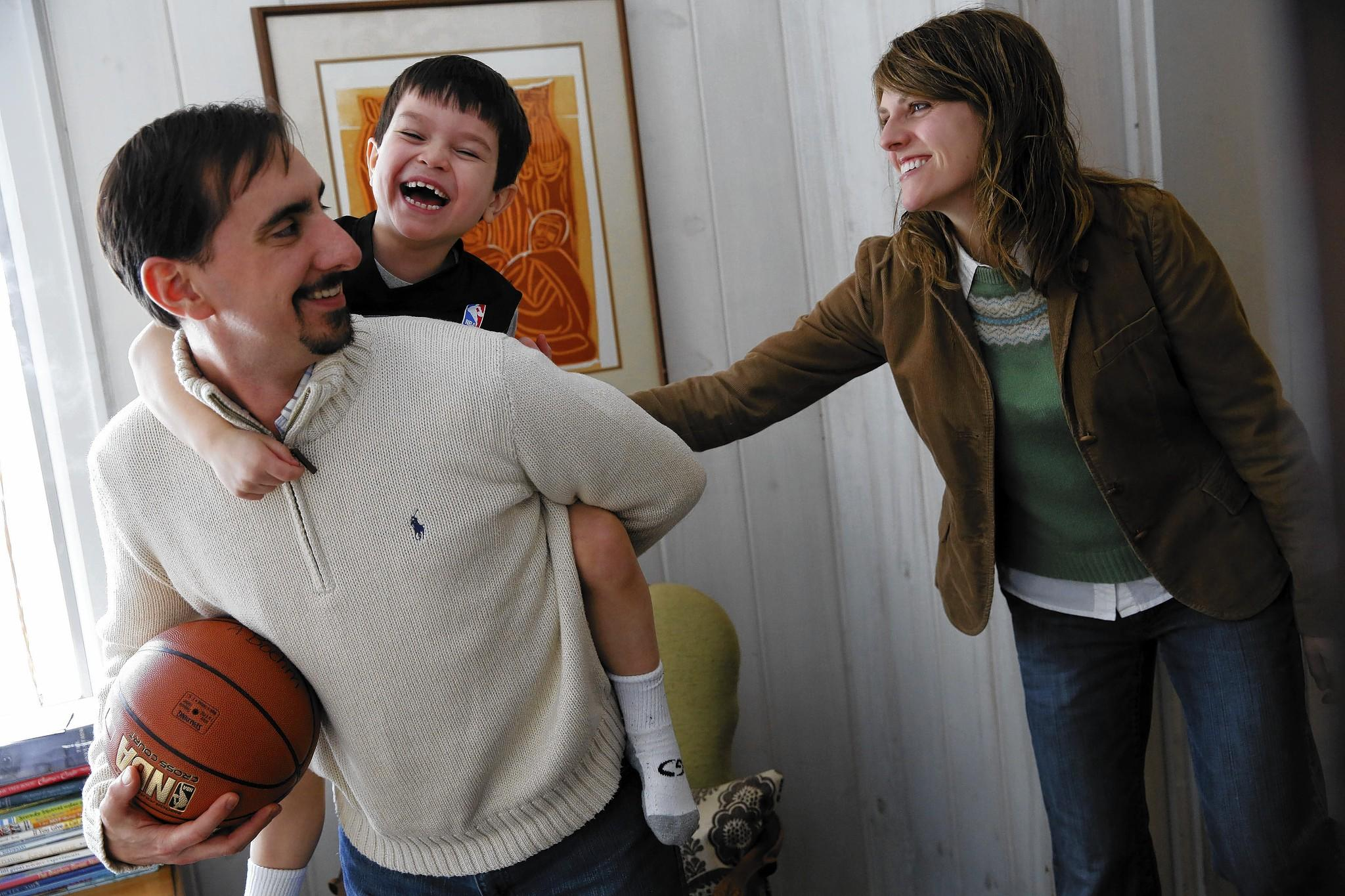 Garrett and Heather Boehm spend some time with their adoptive son Alek, 7, at their Barrington home. The Boehms want to adopt another child from Russia, 2-year-old Anna, but the process was arrested by Russia's decision to ban adoptions by U.S. parents.
