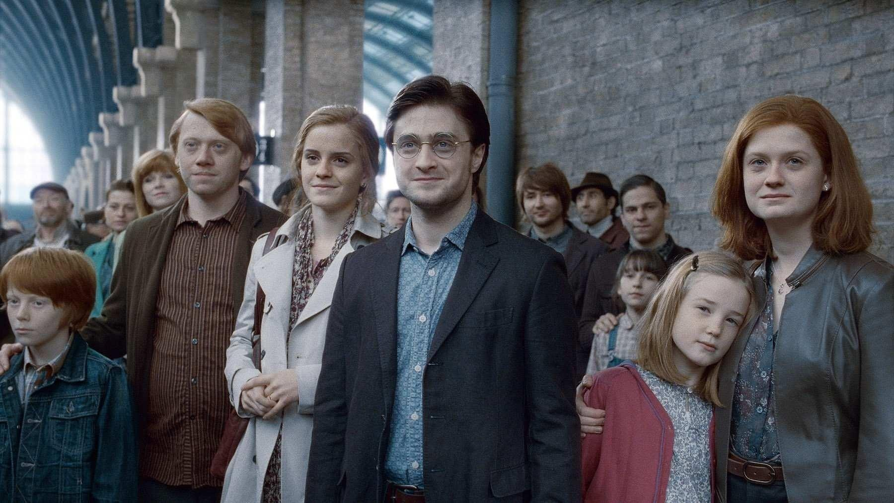 """(L-R) Rupert Grint as Ron Weasley, Emma Watson as Hermione Granger, Daniel Radcliffe as Harry Potter and Bonnie Wright as Ginny Weasley in a scene from """"Harry Potter and the Deathly Hallows - Part 2,"""" depicting the characters as adults with children of their own."""