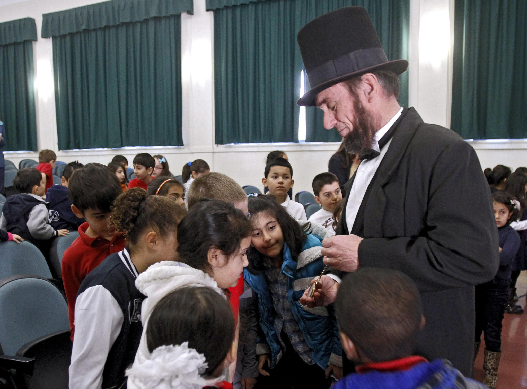 Second graders mingle with actor J.P. Wammack as Abraham Lincoln after he spoke at Marshall Elementary School in Glendale on Wednesday, Feb. 5, 2014. Wammack, as the 16th president, gave a 30-minute talk about the history of the president known as Honest Abe.