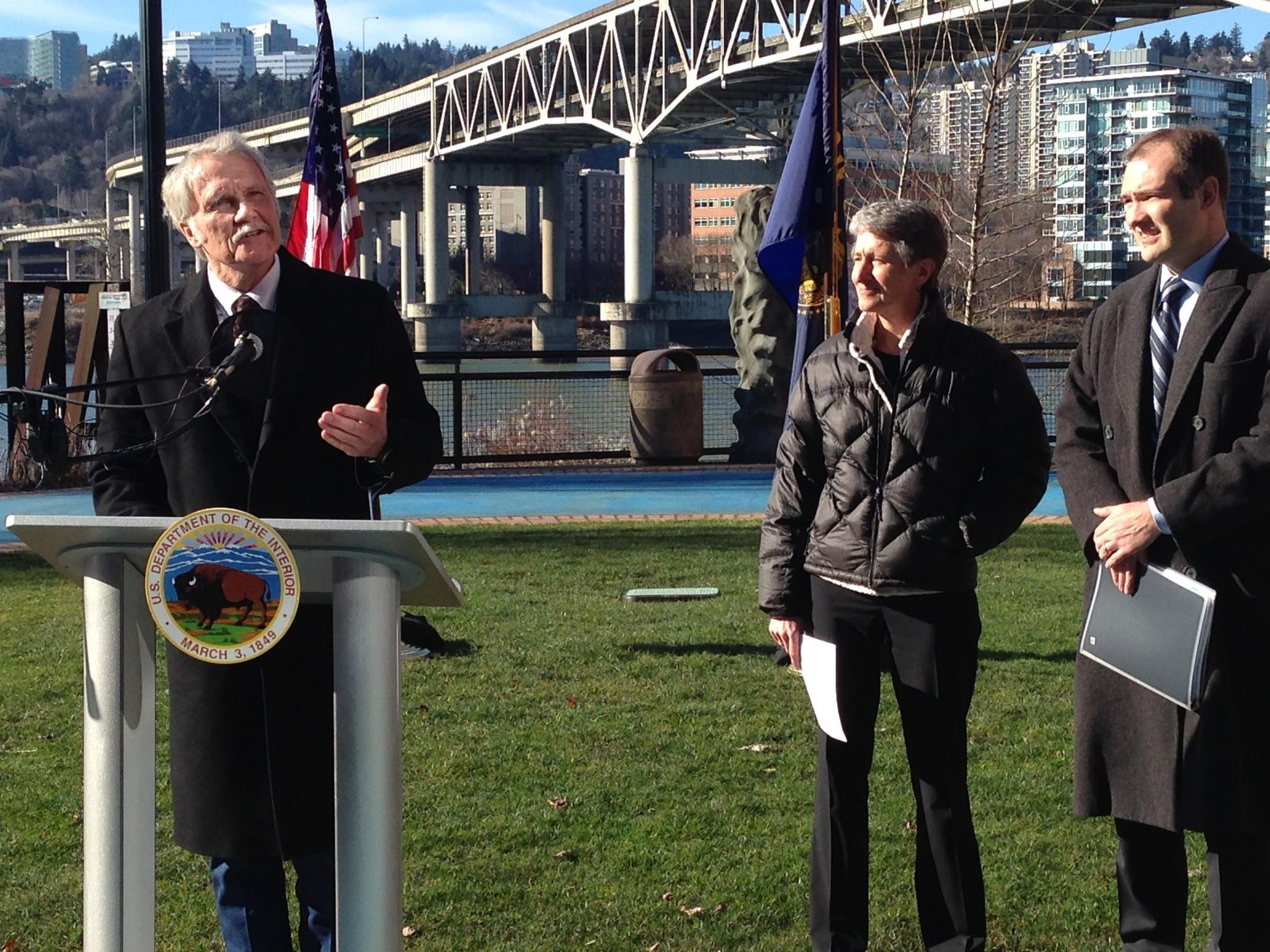 Oregon Gov. John Kitzhaber, left, with Interior Secretary Sally Jewell, announces plans to develop the West Coast's first offshore wind energy farm. Bureau of Ocean Energy Management Director Tommy Beaudreau is at right.