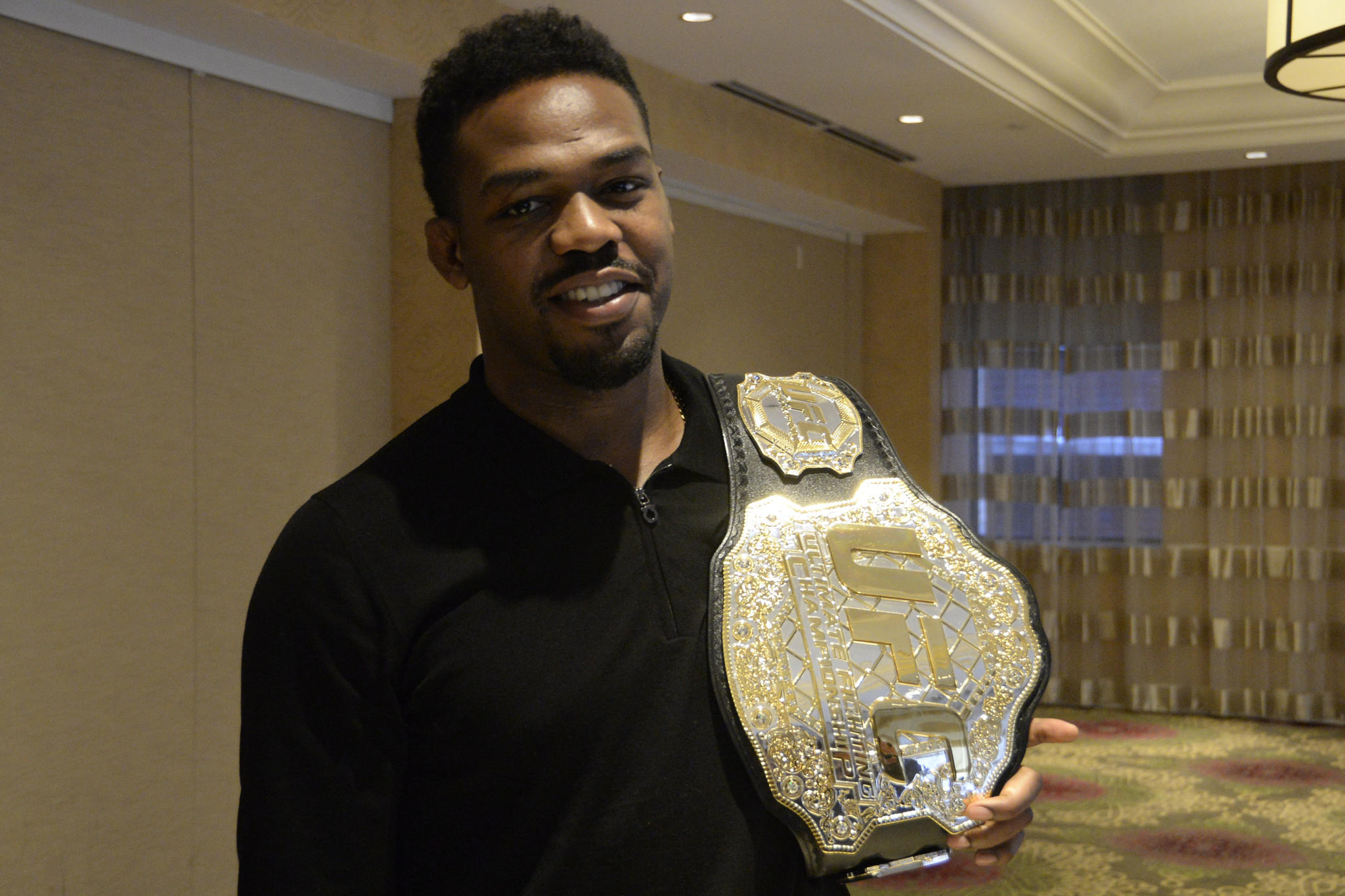 Jon Jones stands with his UFC belt at Monaco Hotel where he was speaking with reporters about his upcoming match in Baltimore.