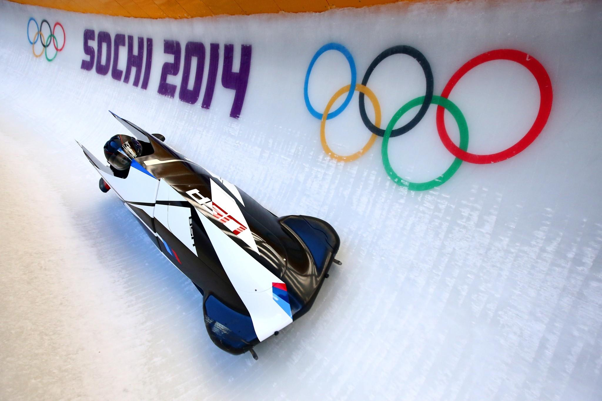 Aja Evans and Elana Meyers practice a bobsleigh run ahead of the Sochi 2014 Winter Olympics. (Al Bello/Getty Photo)