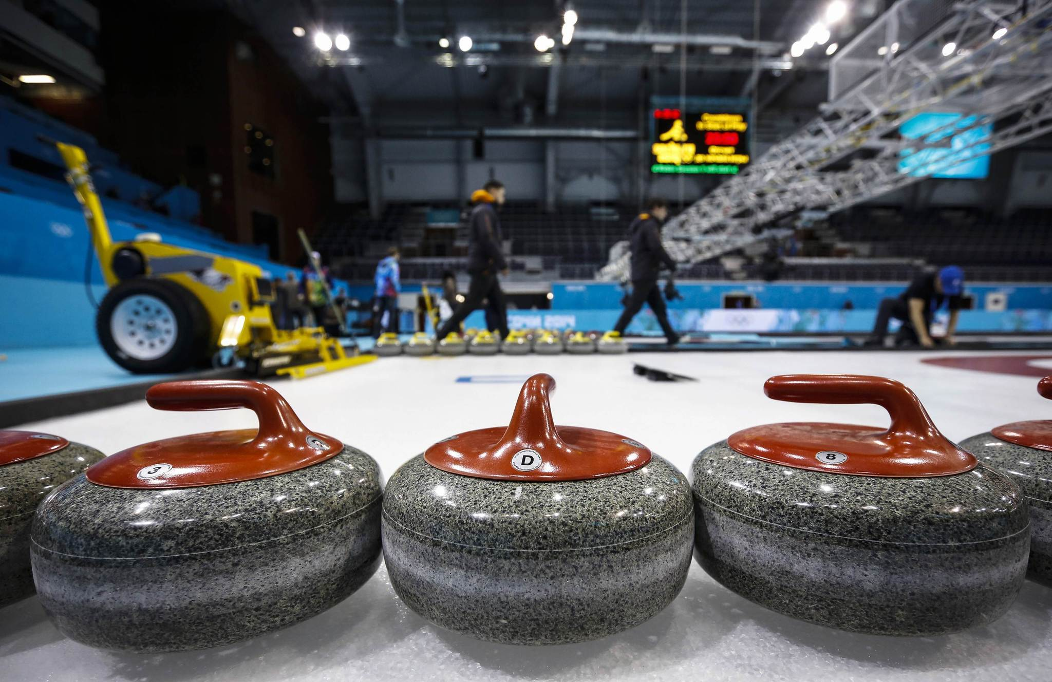 Workers set up the Ice Cube Curling Center as preparations continue for the 2014 Sochi Winter Olympics. (Mark Blinch/Reuters Photo)