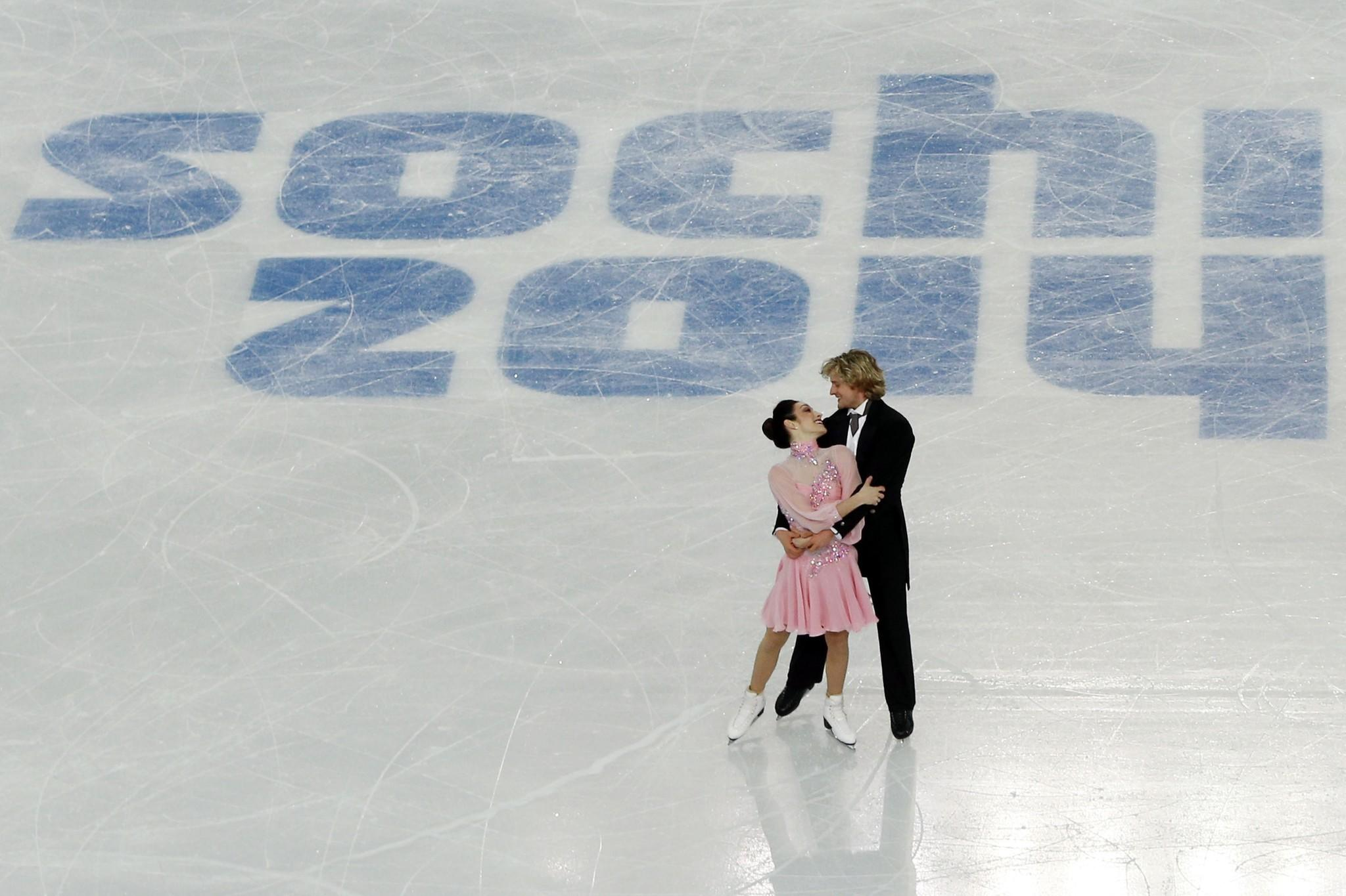 Meryl Davis and Charlie White perform during a training at the Iceberg Skating Palace. (Adrian Dennis/Getty Photo)