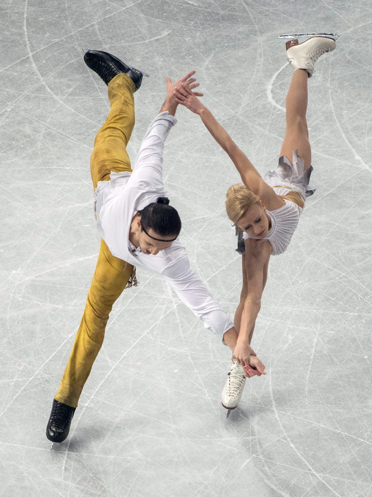 Russia's Tatiana Volosozhar and Maxim Trankov perform at the European Figure Skating Championships. (Tibor Illyes/EPA Photo)