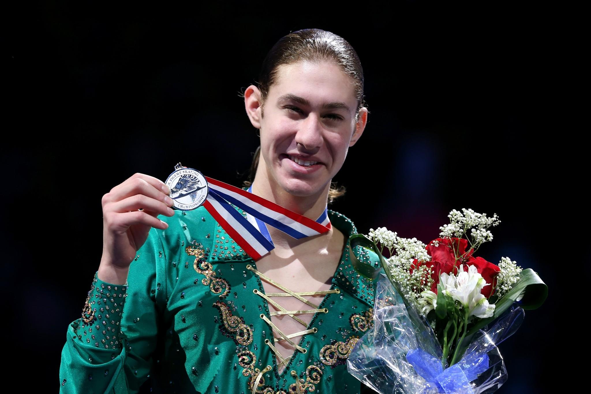 Jason Brown poses for photographers on the medals podium after the men's competition during the Prudential U.S. Figure Skating Championships. (Matthew Stockman/Getty Photo)