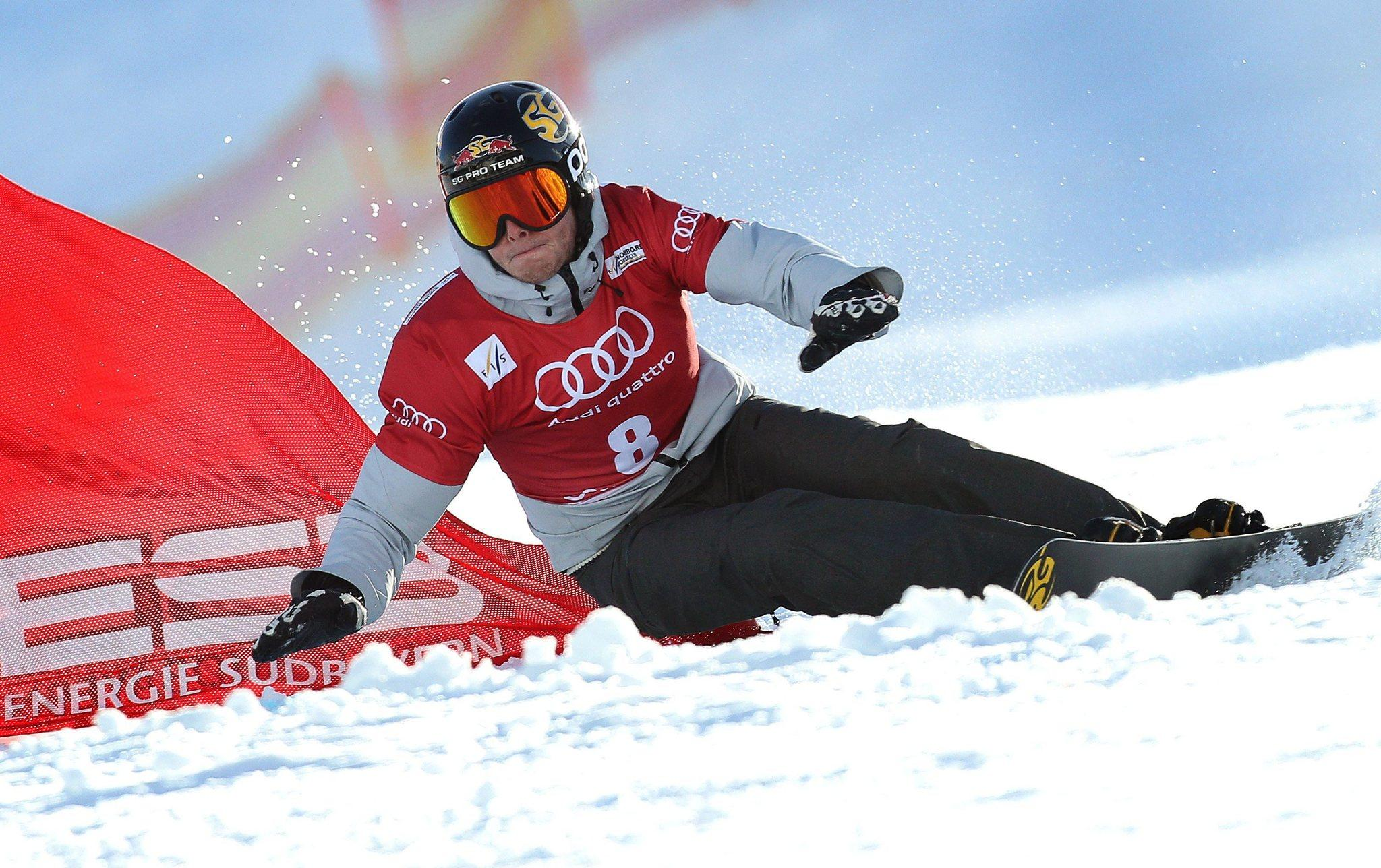 Justin Reiter in action during the men's parallel giant slalom of the Snowboard World Cup. (Karl-Josef Hildenbrand/EPA Photo)