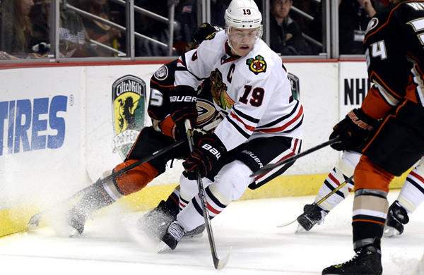 Blackhawks forward Jonathan Toews gains control of the puck against the Ducks on Wednesday night at Honda Center.