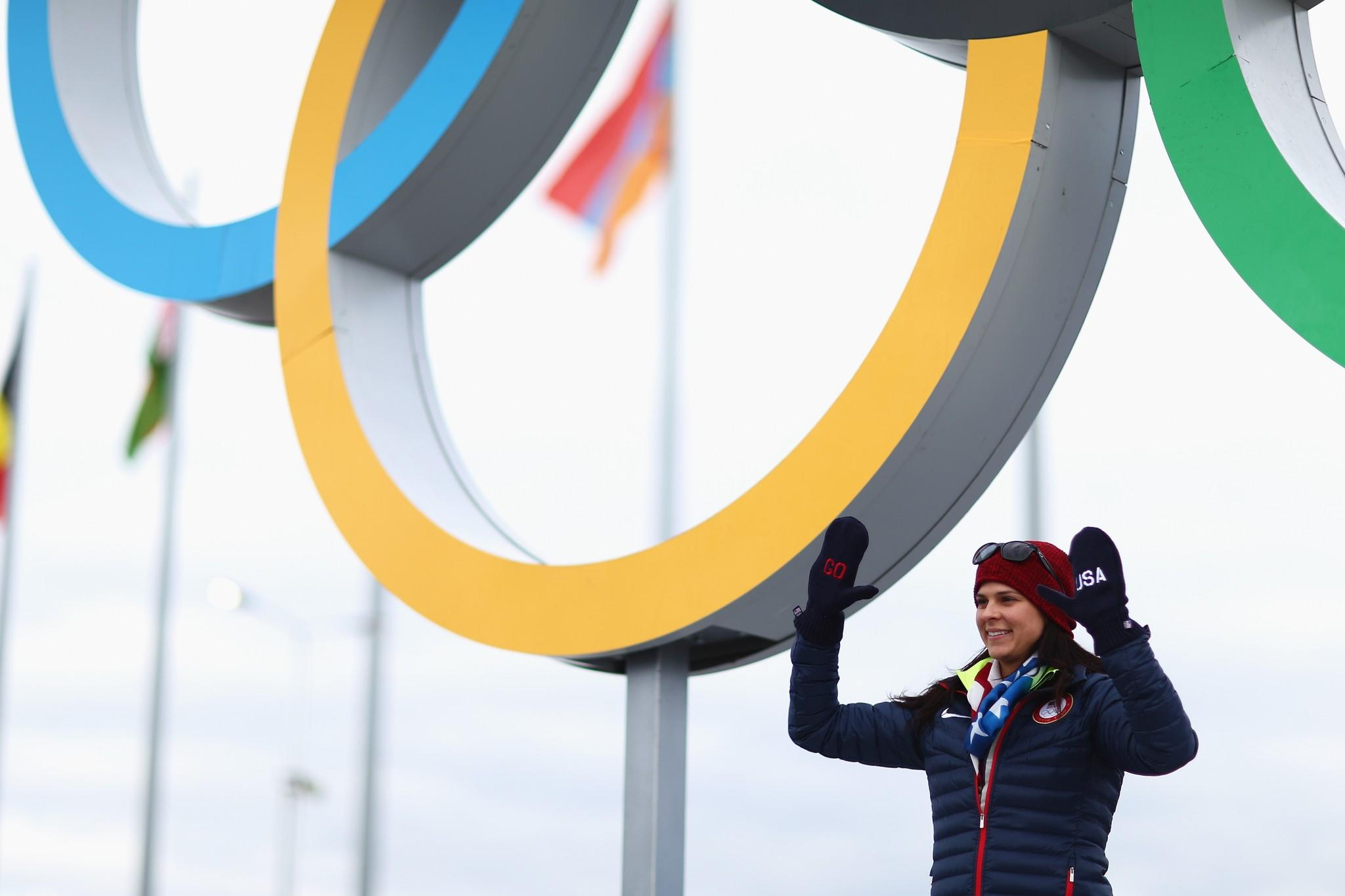 Speedskater Brittany Bowe poses in front of the Olympic rings. (Clive Mason/Getty Photo)