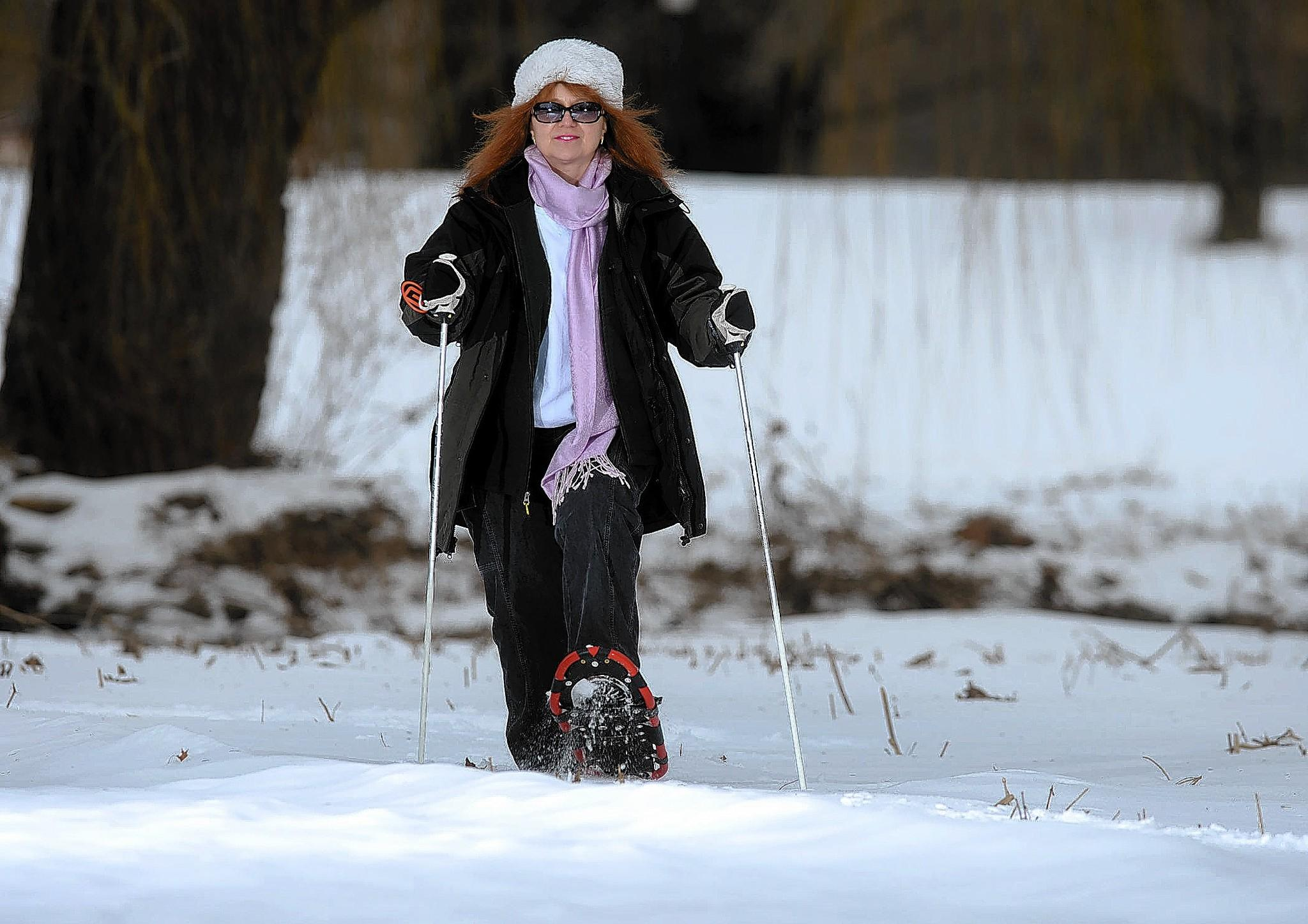 Karen El Chaar of Friends of the Allentown Parks demonstrates snow shoeing in anticipation of Allentown's Winterfest at Cedar Creek Parkway in Allentown Feb. 8.