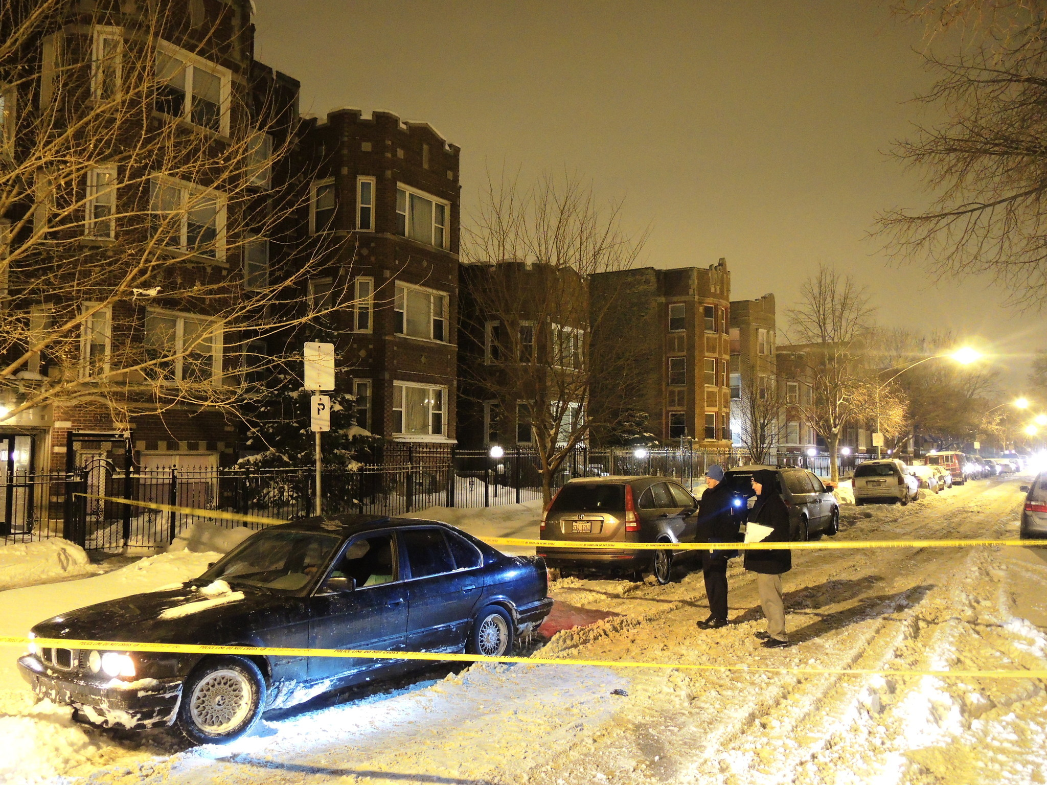 Chicago police investigate at the scene where Corey Williams, 29, of the6000 block of South Richmond Avenue, was fatally shotin the 8100 block of South Marshfield Avenue early Feb. 6, 2014.