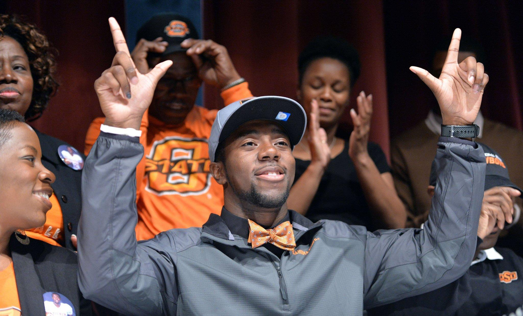 Kirk Tucker celebrates after he signed with Oklahoma State during signing day at Tucker High School in Tucker, Ga.