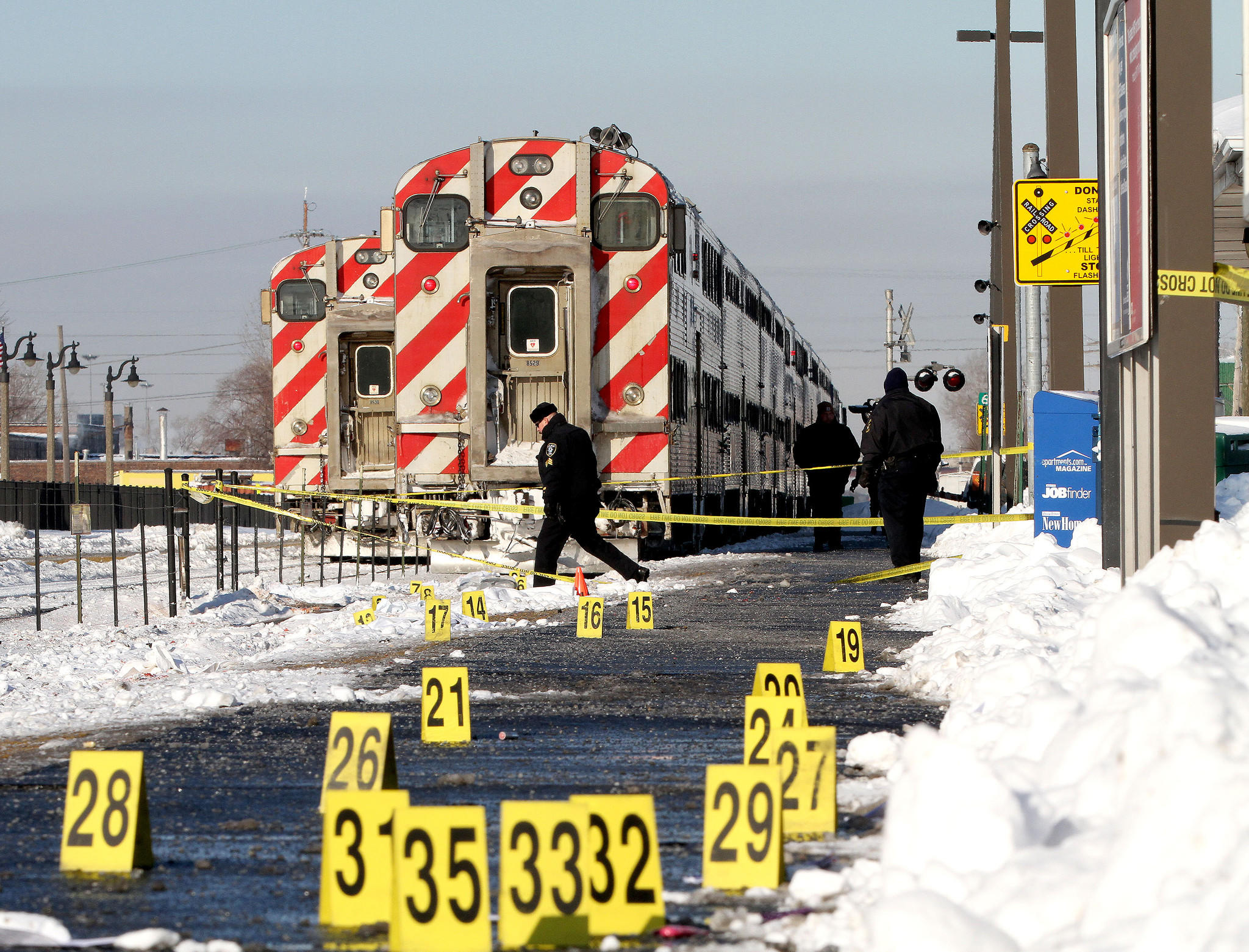 Metra police and Franklin Park police investigate the scene where a woman was struck and killed by an outbound Metra train.