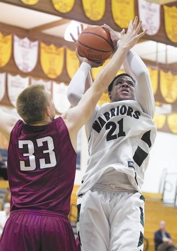 Brethren Christian's Cameron Griffin shoots over St. Margaret's Jameson Edwards in an Academy League game on Thursday.