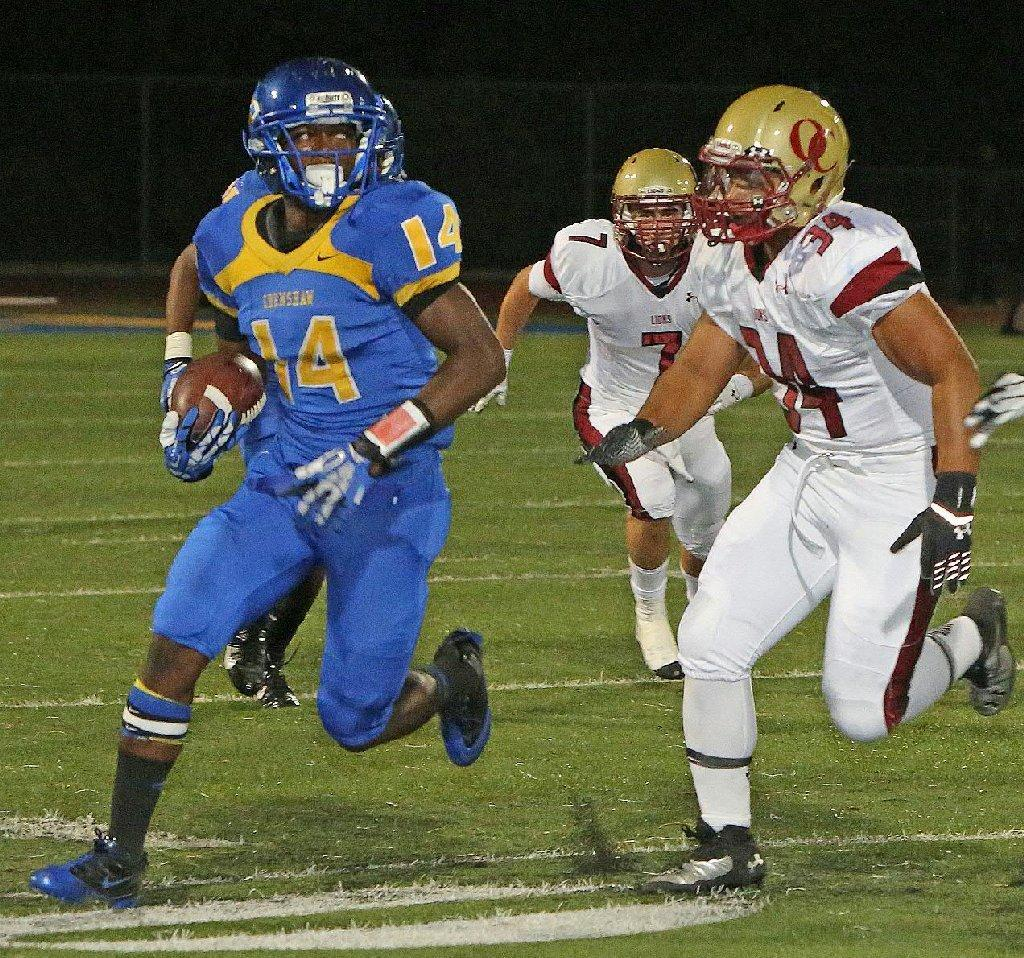 Crenshaw's Michael Simmons, left, runs against Oaks Christian High on Sept 27.