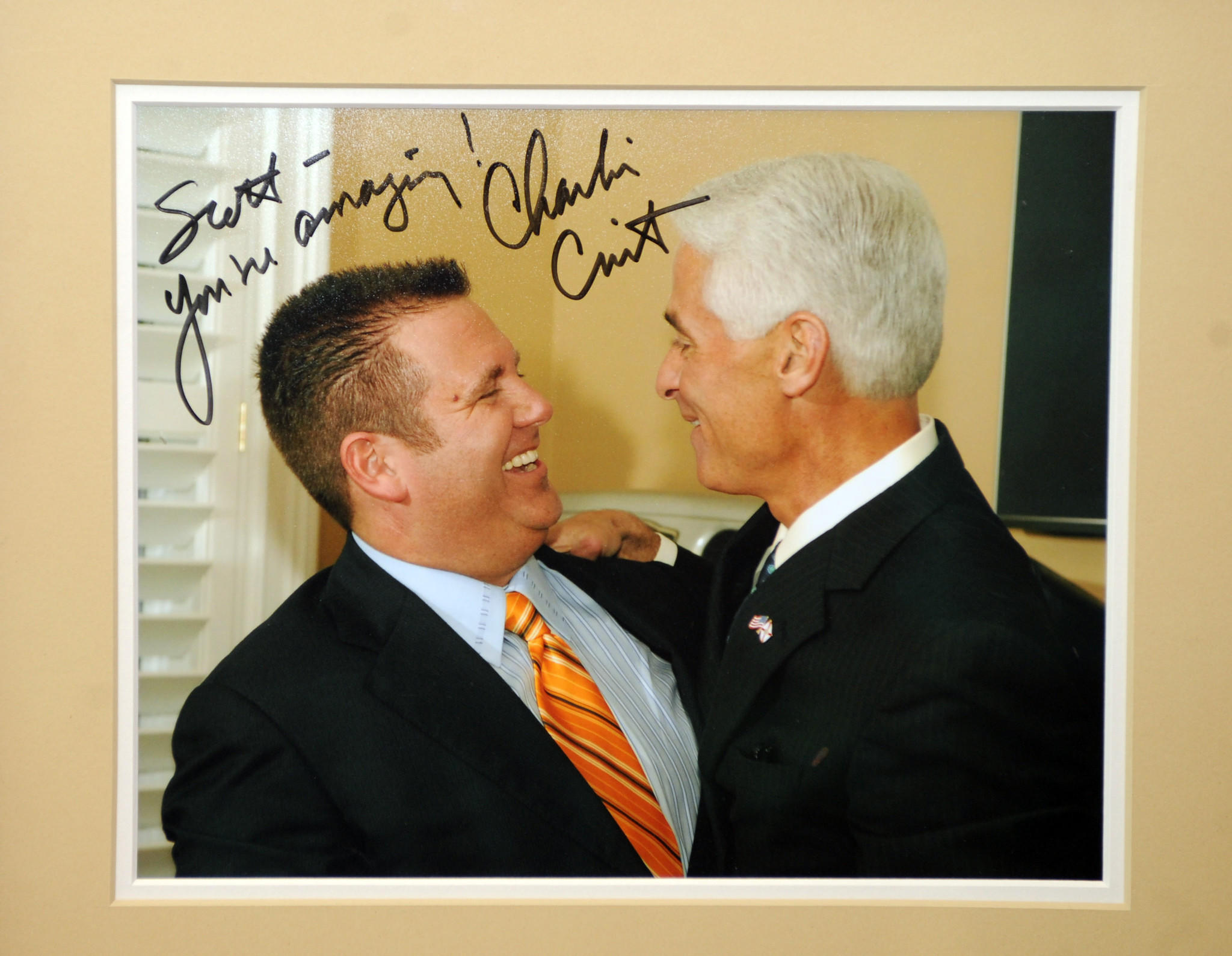A photo of Governor Charlie Crist and Scott Rothstein in Rothstein' office in Ft. Lauderdale Carline Jean, SunSentinel