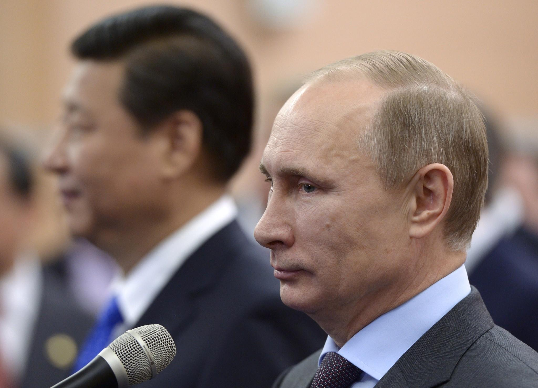 Russia's President Vladimir Putin and his Chinese couterpart Xi Jinping (left) meet in Sochi.