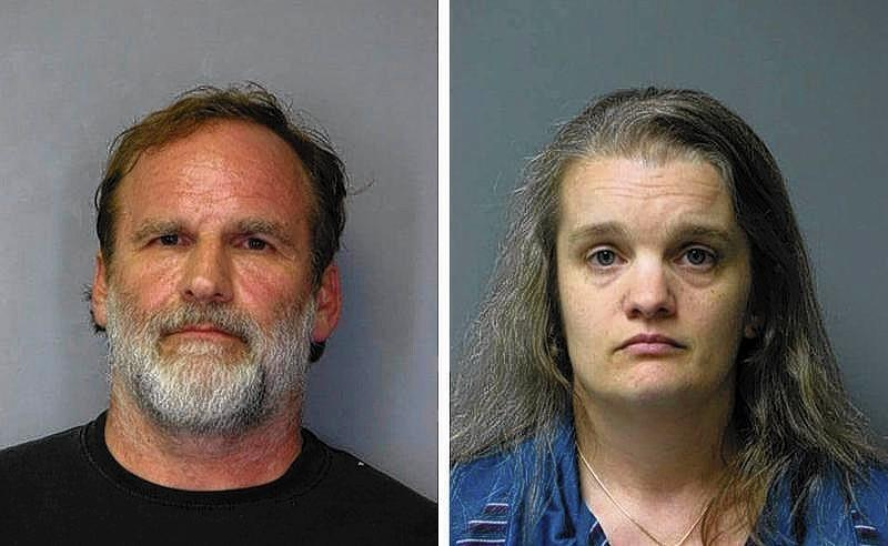Dr. Melvin Morse, 58, and his wife Pauline, 40, are seen in this combination of booking photos released by the Delaware State Police from Aug. 9, 2012.