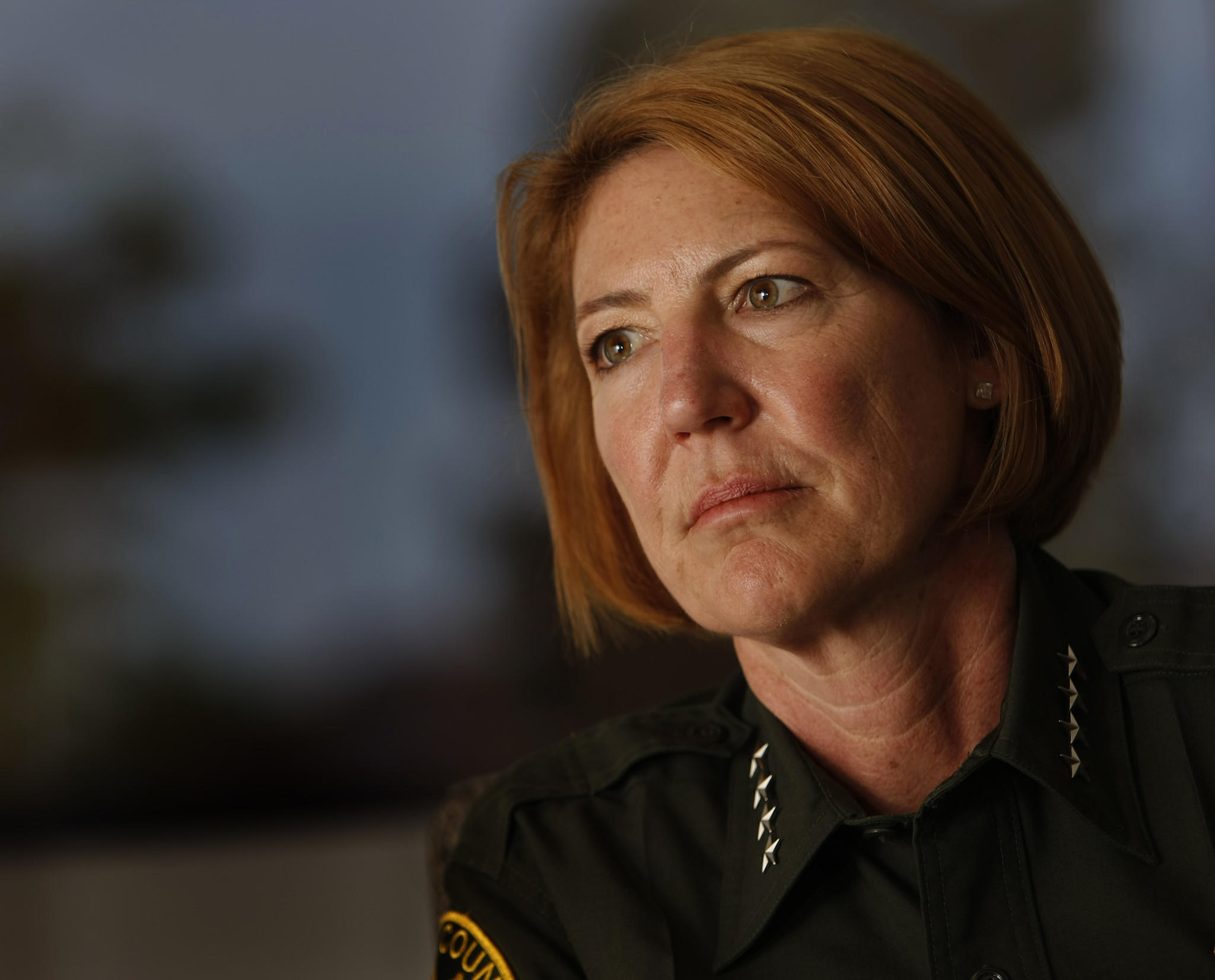 Orange County Sheriff Sandra Hutchens says she has a delicate balancing act on her hands.