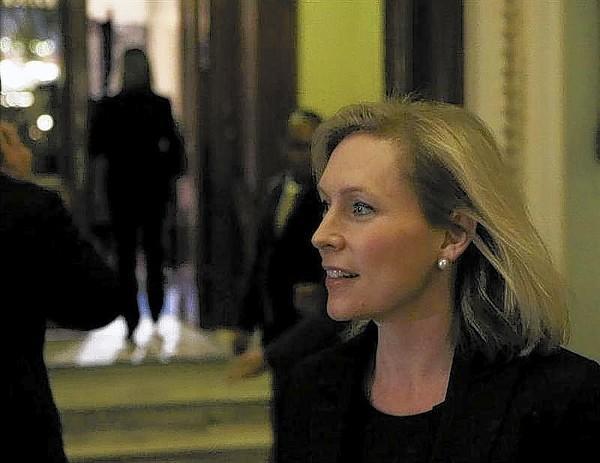 Senator Kirsten Gillibrand (D-NY) walks to an interview on Capitol Hill in Washington on Nov. 21, 2013.