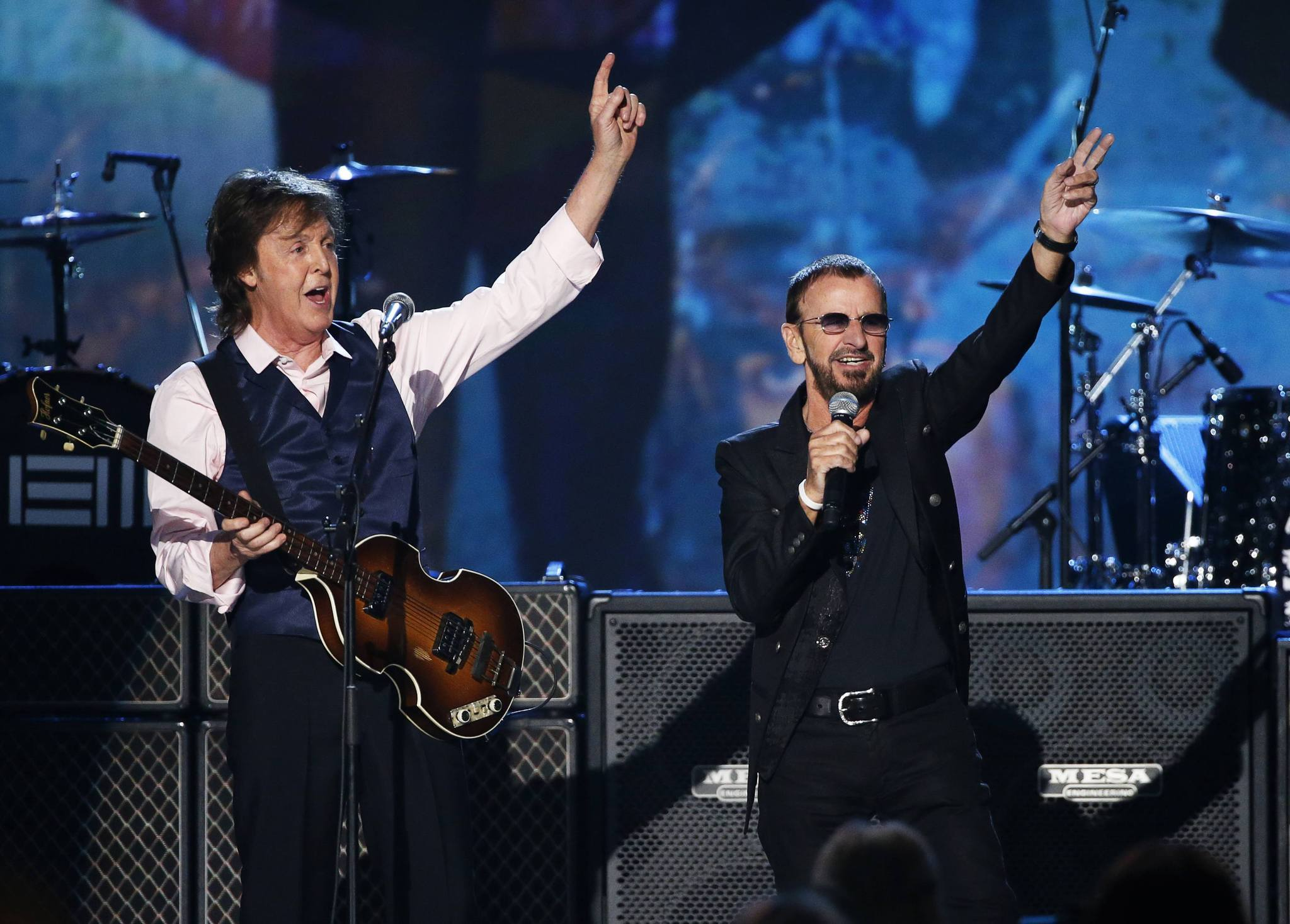 "Paul McCartney (L) and Ringo Starr perform during the taping of ""The Night That Changed America: A Grammy Salute To The Beatles"", which commemorates the 50th anniversary of The Beatles appearance on the Ed Sullivan Show."